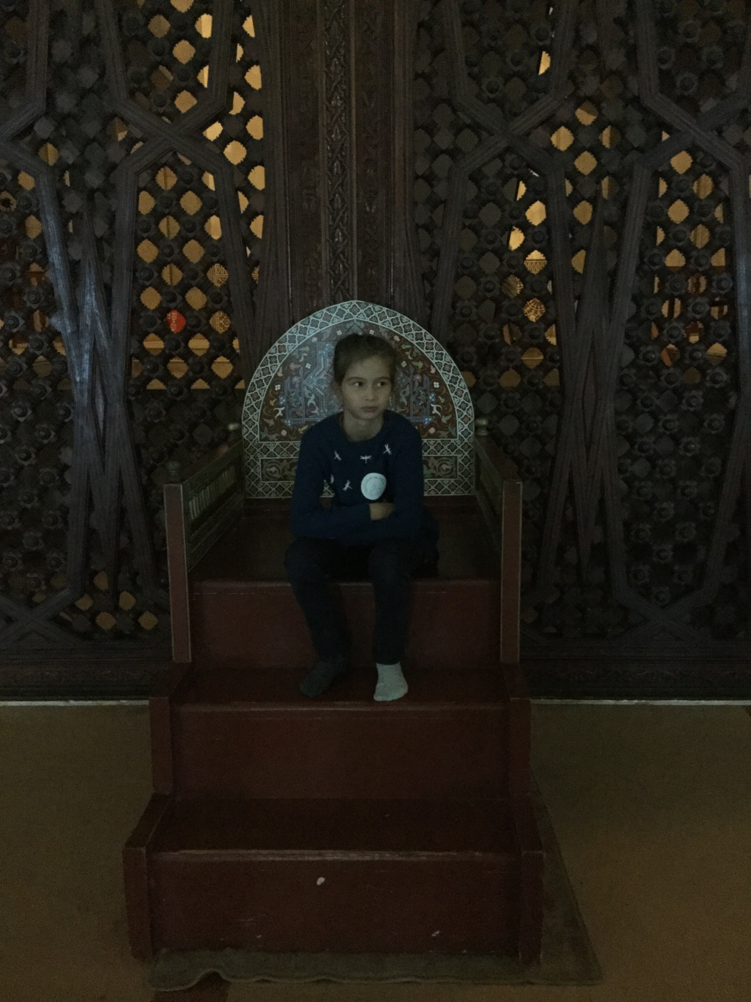 Lili also got to sit on the chair of the catechism instructor. Note the odd socks and the look of deep reflection ...