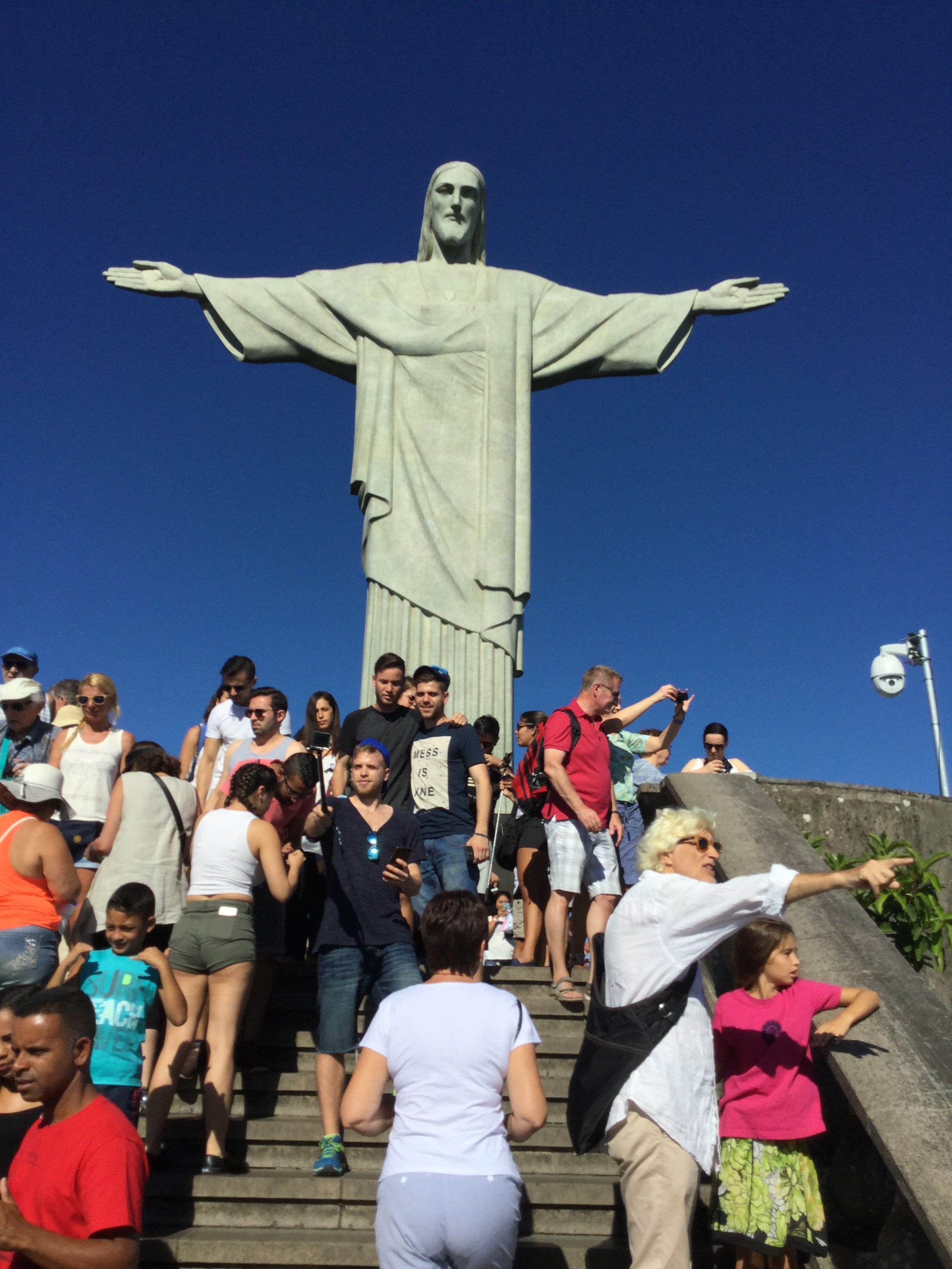 We got there early, it opens at 8 am. The peak soon becomes a mess of people jumbling over each other, selfie sticks everywhere and tour guides trying to keep their flocks in order and within earshot. The thing to do of course is to take a picture with arms outstretched in front of the statue!