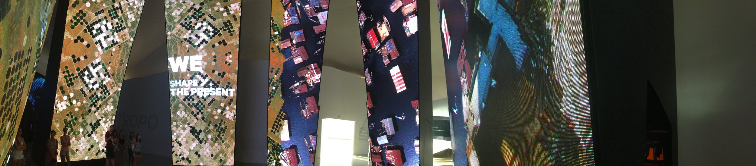 Another panorama of the multimedia screens.   We got swipe cards at the entrance that we could place on exhibits and then the text all switched to English. You could type in your name and email address and then the museum would remember which exhibits you had seen (and they can of course track what people view). It is a really high tech place.   We visited on the day of free admission (another benefit of an unhurried sabbatical) so there were quite a few people but we looked in detail into some screens that talked about the future of DNA modification, artificial body parts, individualized medicine and the ethical questions around scientific advances. We have also watched our favorite vet program on the iPad and learned about harvesting stem cells to treat illnesses - in that case for kidney failure in a cat. I love how the stuff we see starts to have connotations for Lili. This makes for great conversations.