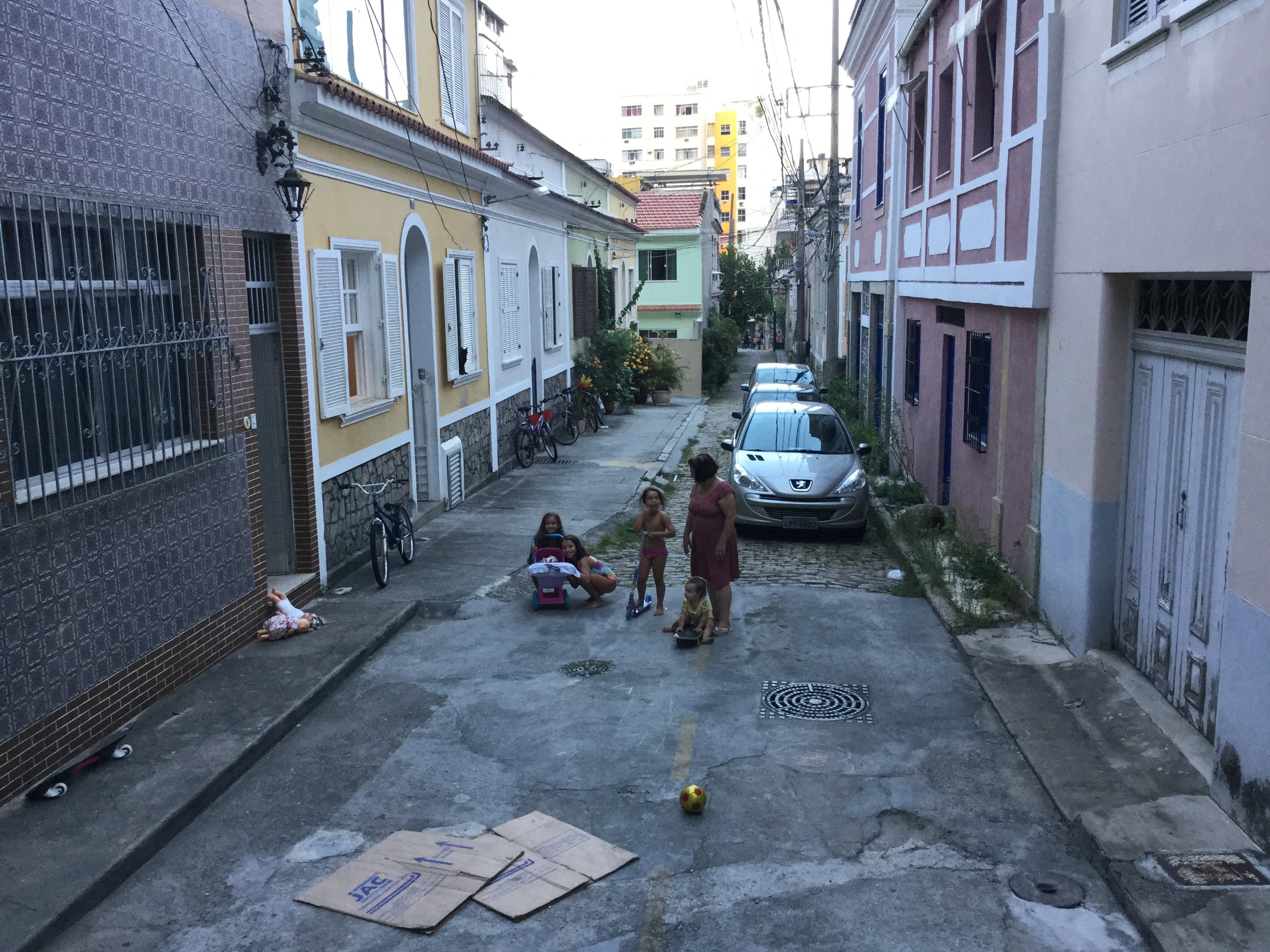 This flat area is at the bottom of the stairs. It is not much more than a parking area but it became the stage for numerous games and fun for the children.