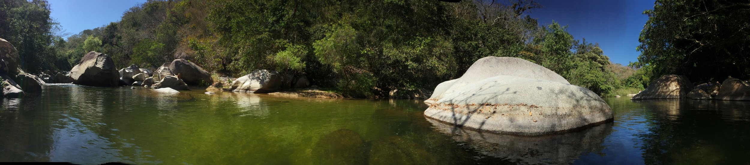 Panorama of the river. Waterfall is on the very left.