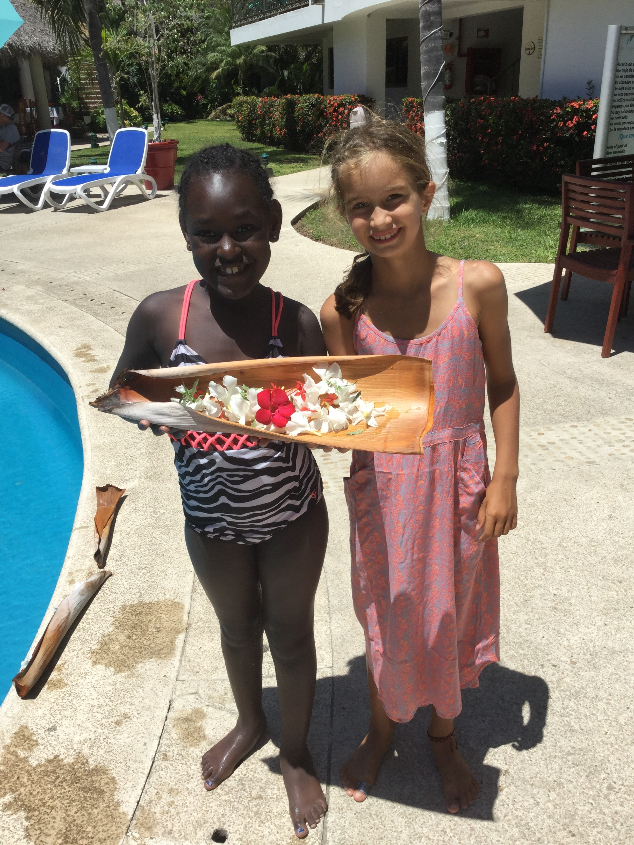 Lili and friend Kaylee from Oregon made little flower rafts for the pool. Kaylee was born in Ethiopia!
