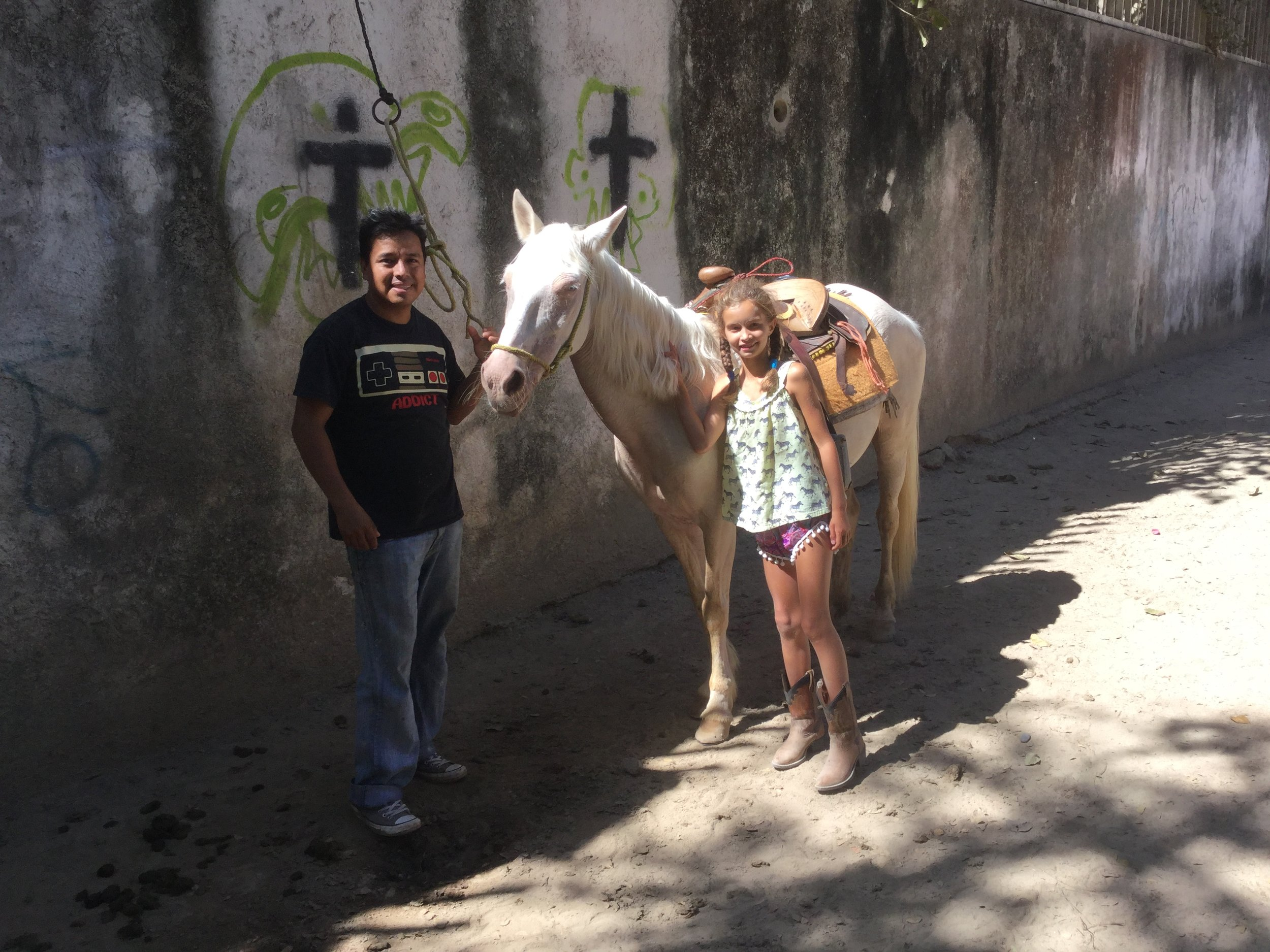 This is Jehu with Lili after one of the rides. This horse is Chilindrina - and she is also pregnant. Other horses that Lili rode were Galleta, and Lucero. Chava normally rode Mariposa and Jehu rode Cuervo or sometimes Scorpion. There was also Coqueta (that had the colt) and Susana (John from Texas rode Susana).