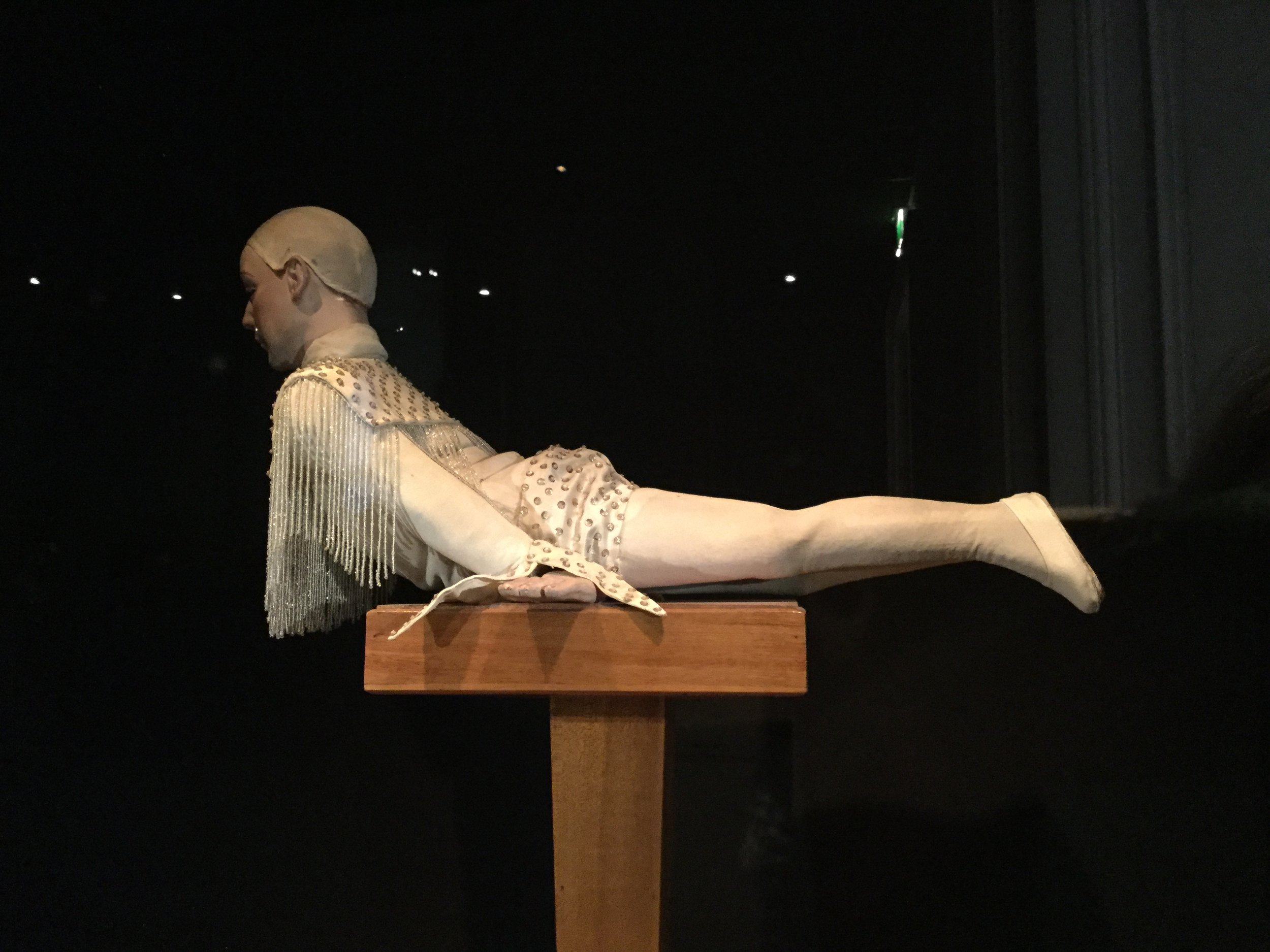 An area of moving dolls and marionettes. This one is called the Acrobat on a Tightrope.