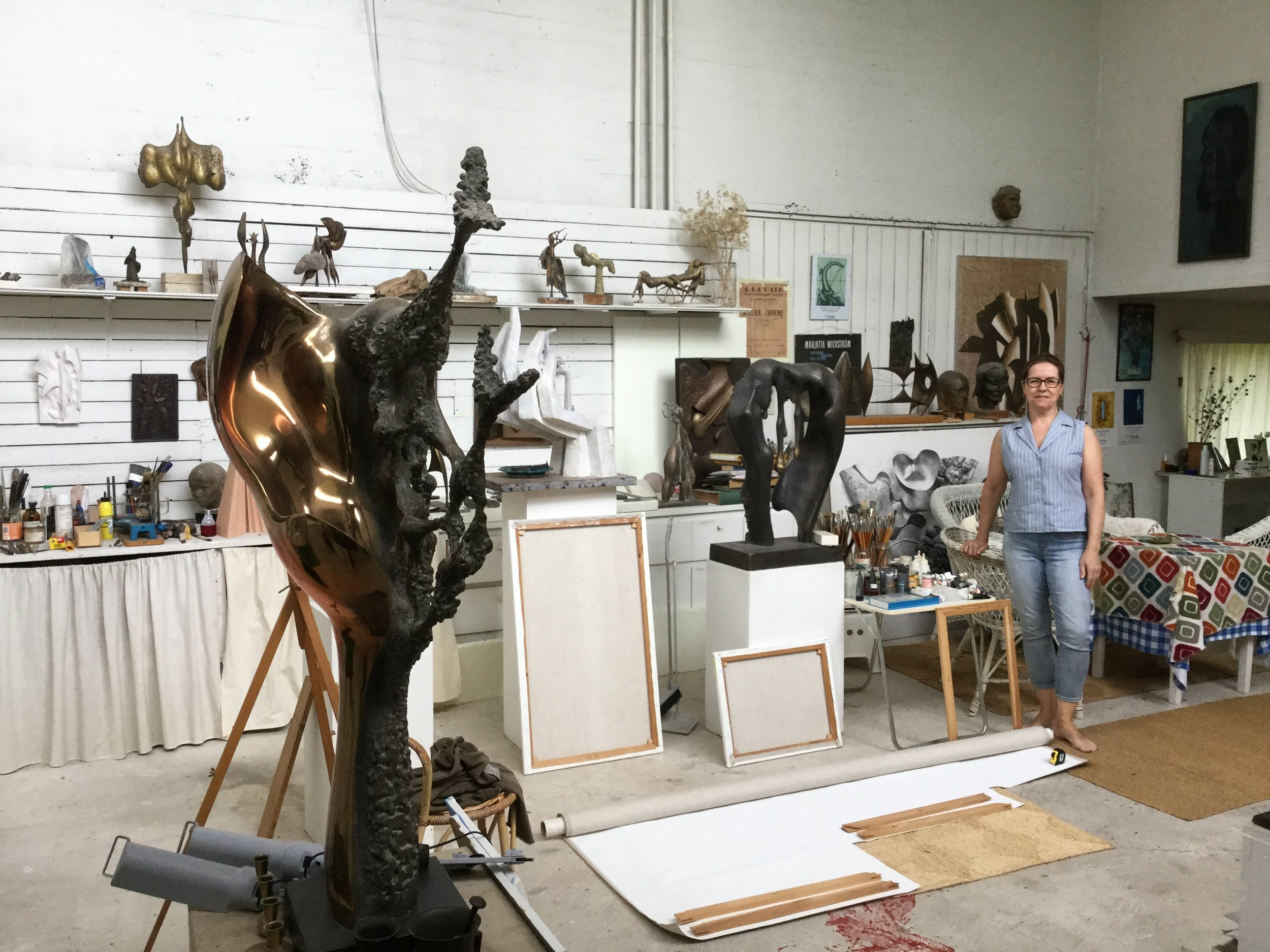 Riikka in her Mom's atelier. The sculptures are so lovely. These days the space is also used by Tuomas, Riikka's brother - the canvases are his.