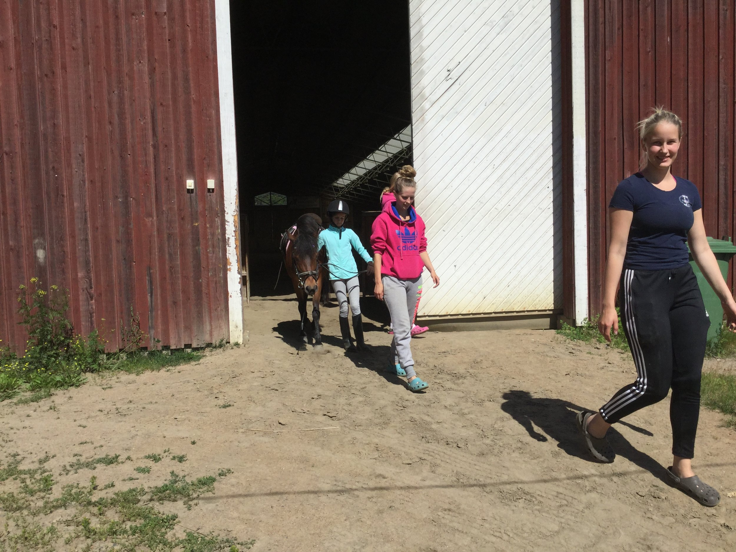 Coach Siiri in the front, and Lili leading Guni out after the class.
