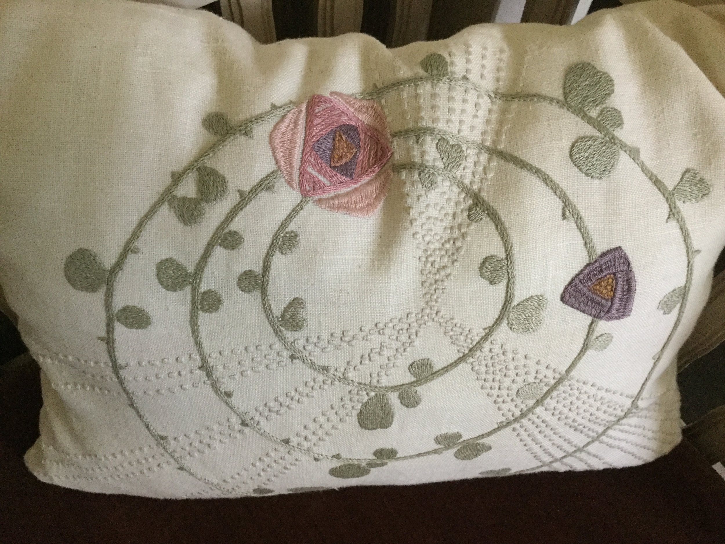 A pillow from the 'Rose' design by Saarinen in the upstairs garden room.