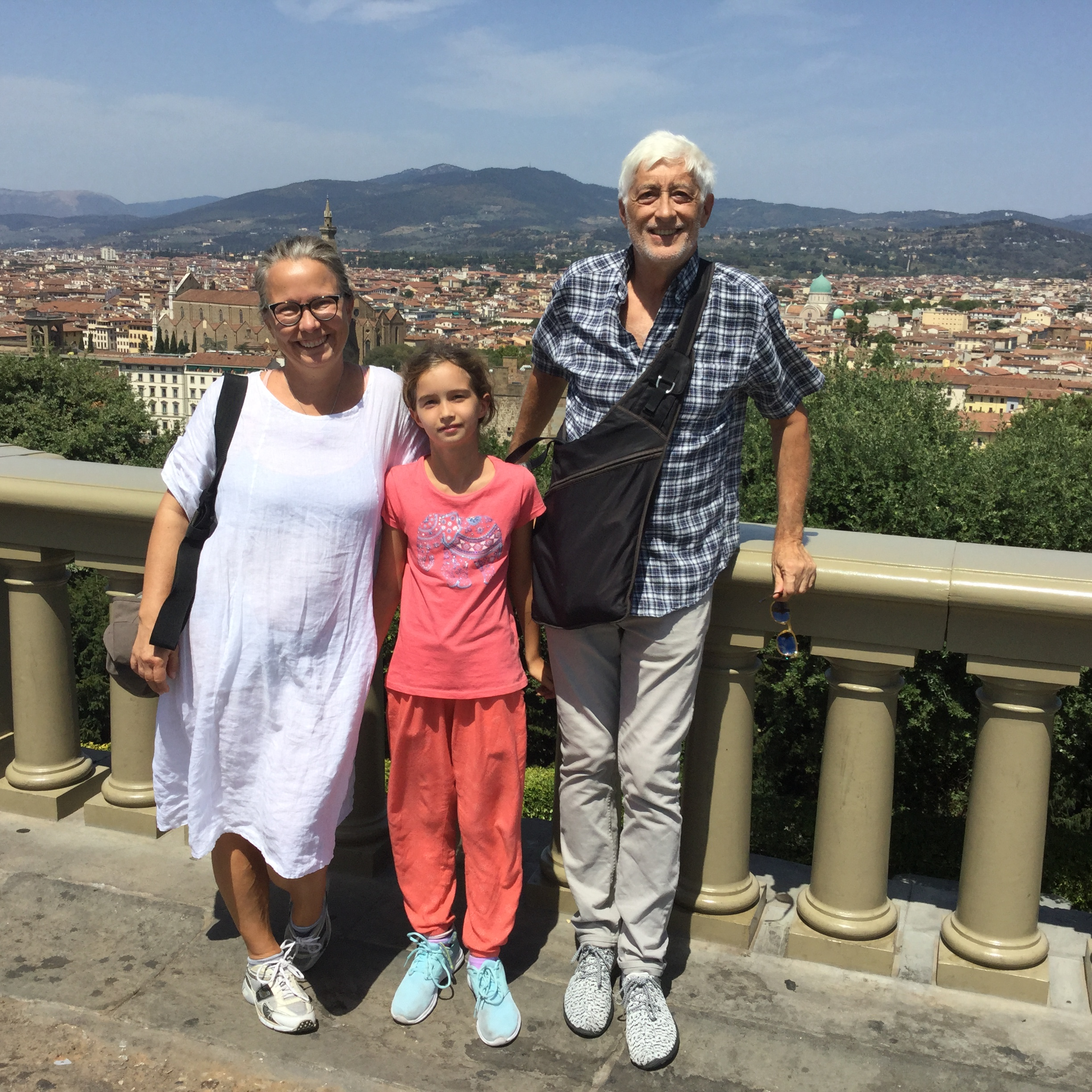 Happy traveling family at Piazza Michelangelo.