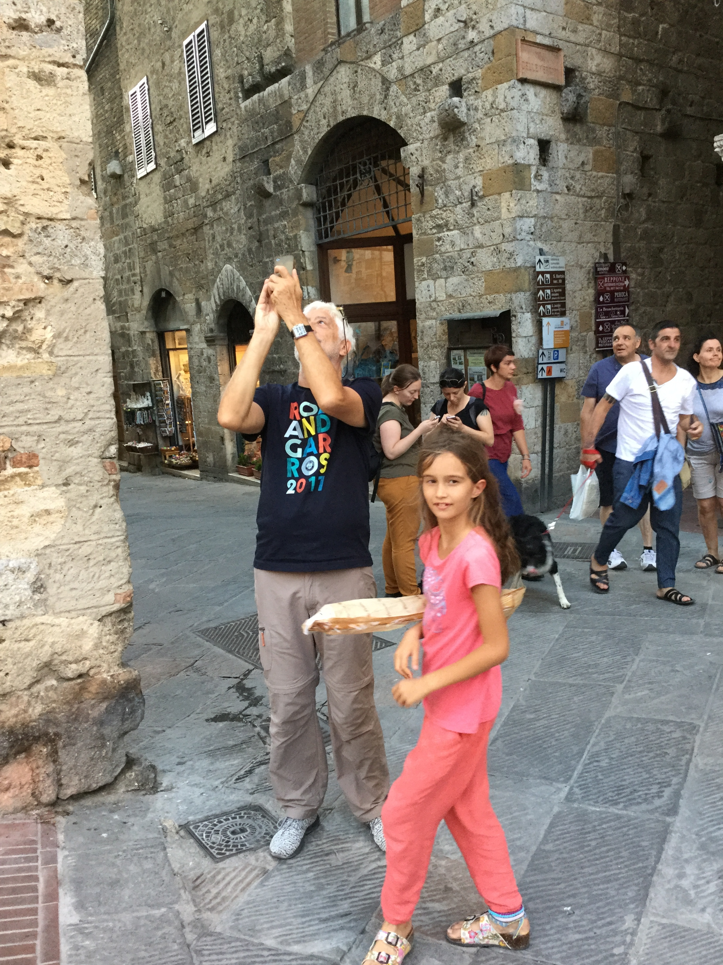 This is what tourists in San Gimignano look like: bending backwards and looking up to photograph a tower!