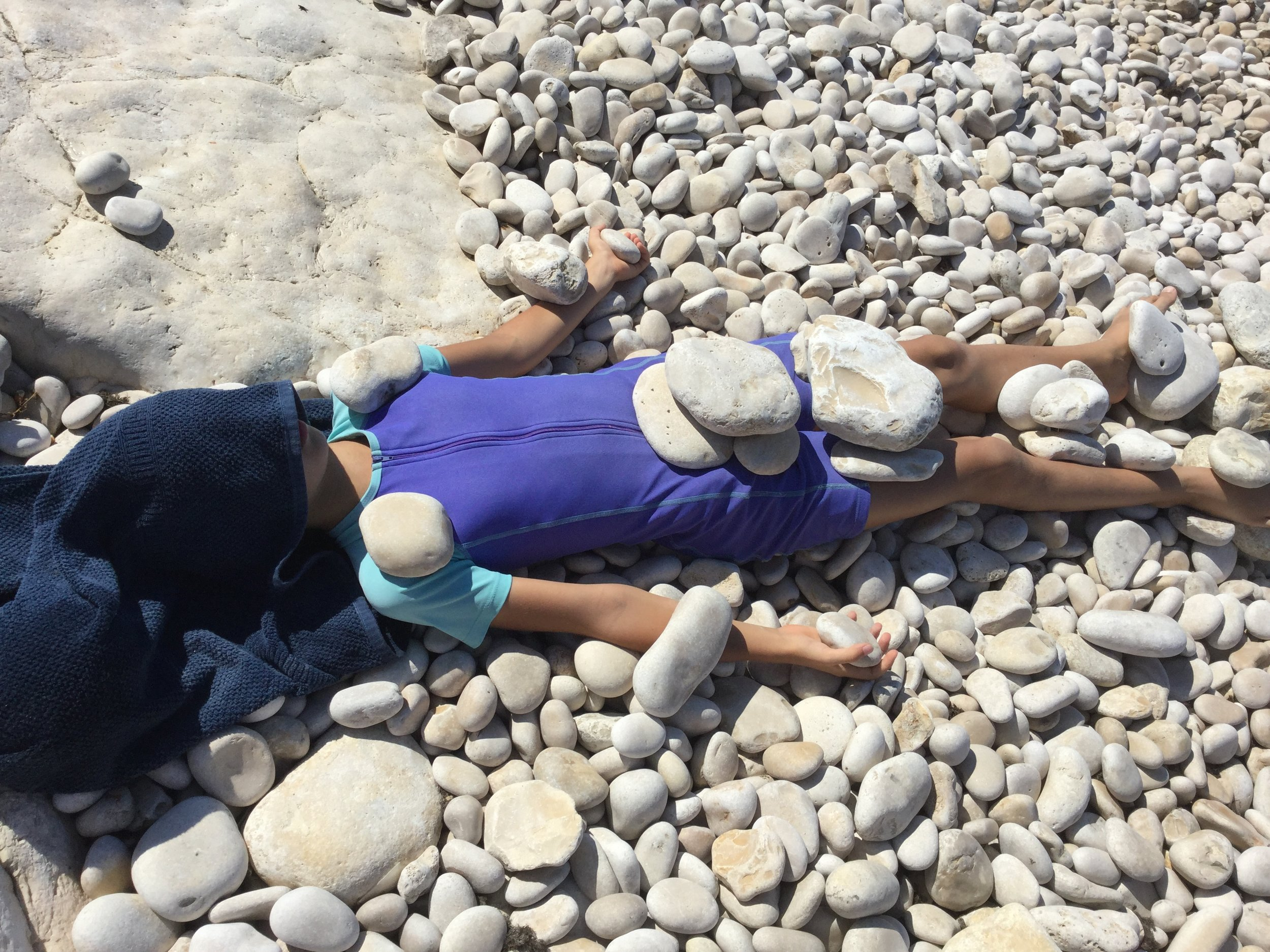 I also gave Lili a long warm stone Shavasana with head massage on the beach. She loved it.