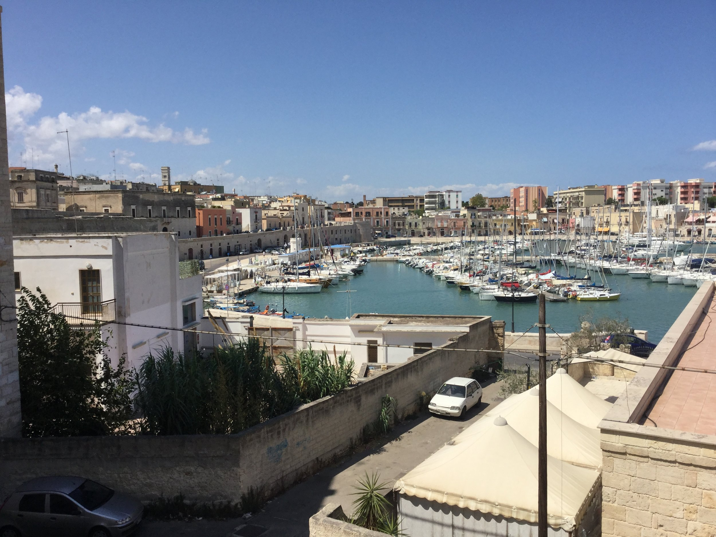 This is th center harbor of Bisceglie. We live in Palazzo Ammazzalorsa, the big building with five white windows next to the pink building under the tower on the left.