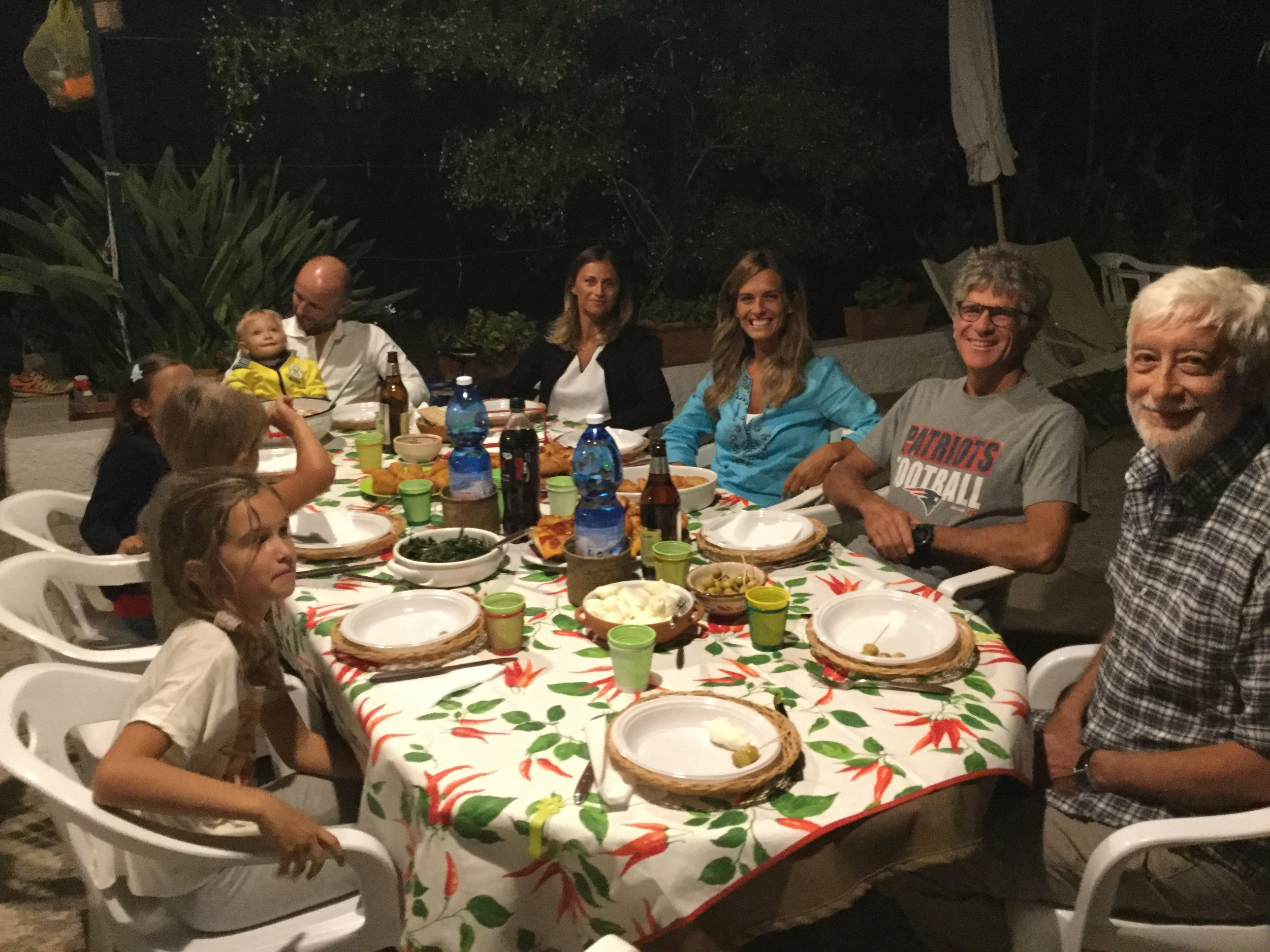 Enjoying a dinner at Corrado's Molfetta house. It has been in their family for several generations and sits in the middle of a large olive grove.