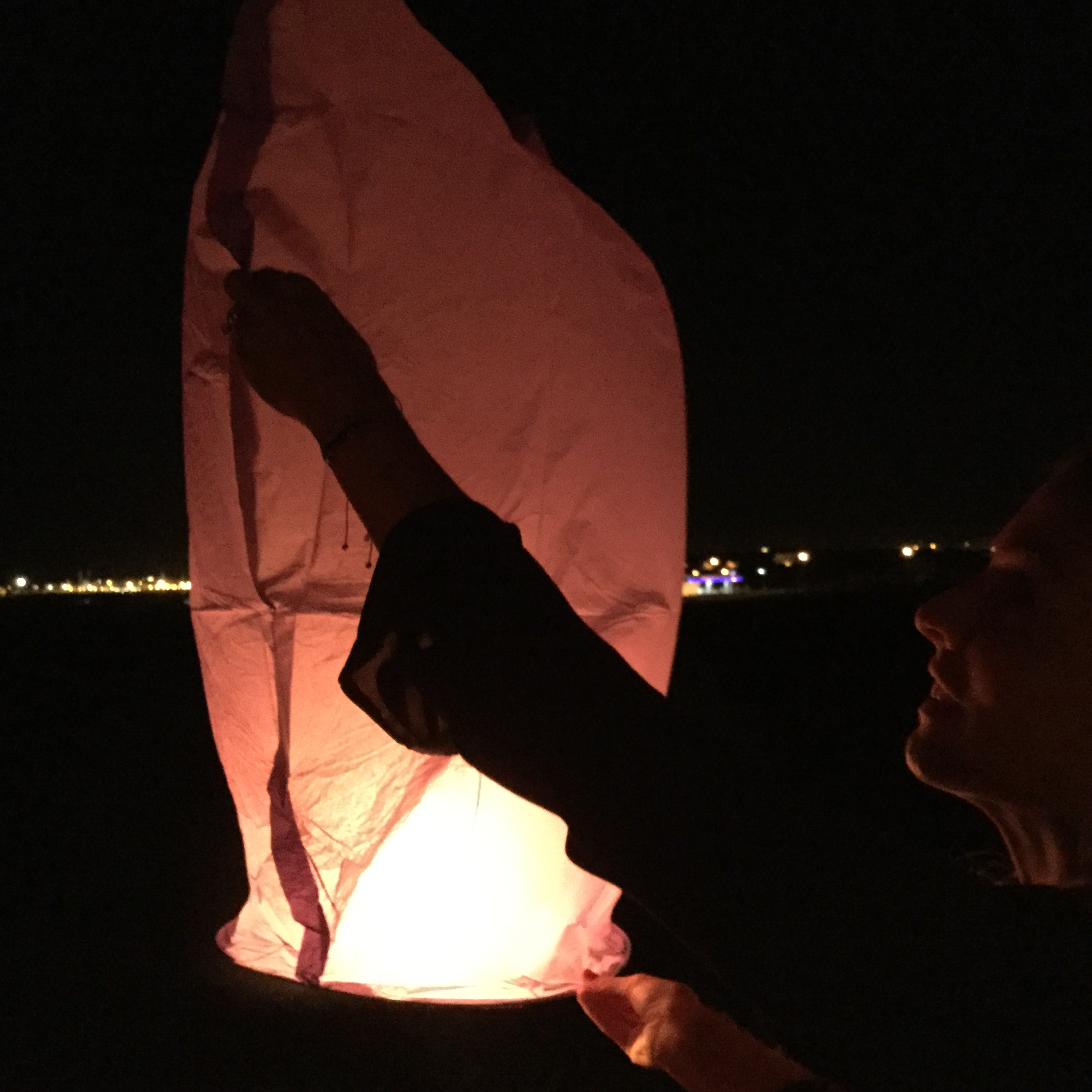 At the end of the evening there was an absolutely wonderful moment when we released eight paper lanterns to the sky from the roof patio of the house.