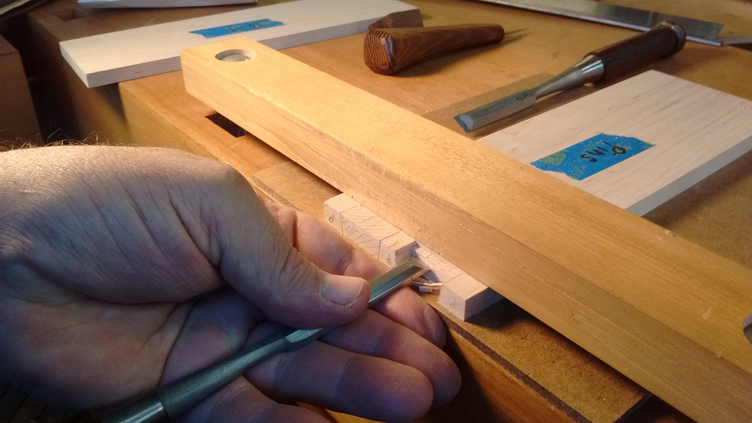 Removing the waste between dovetail pins
