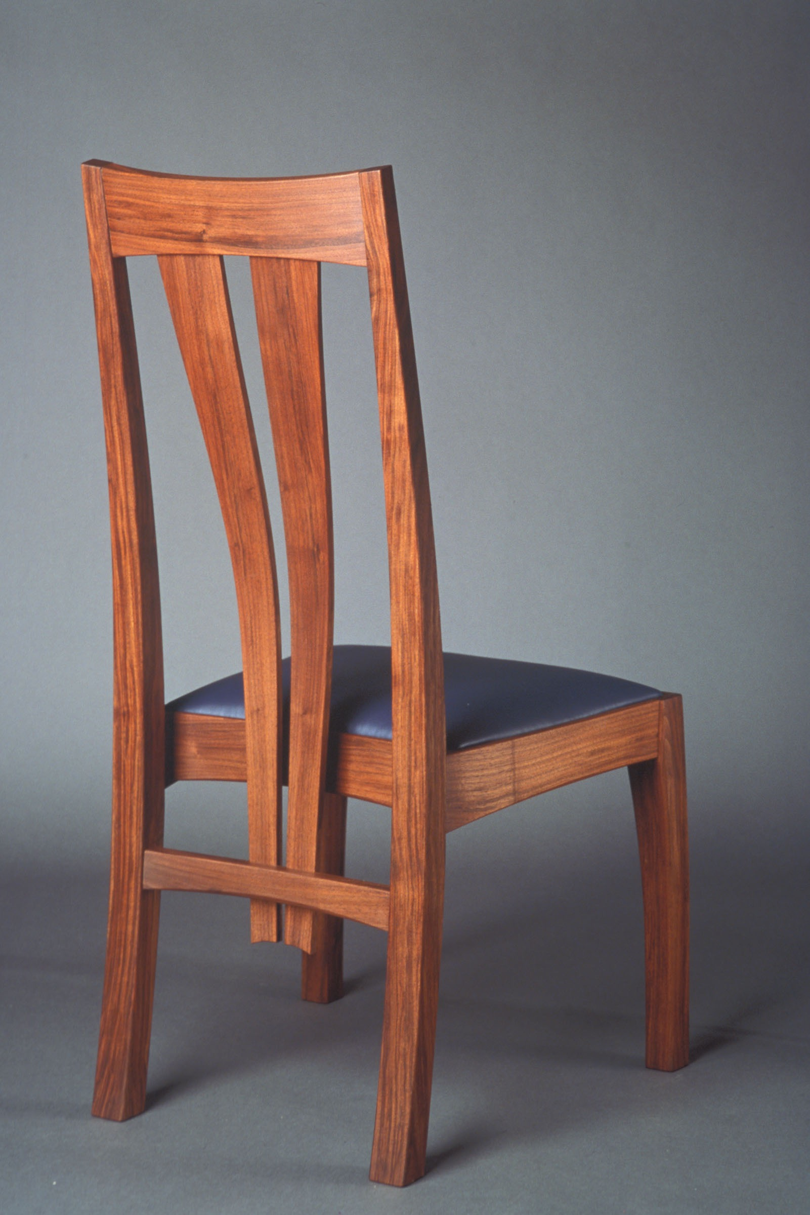Walnut dining chair with bent laminated back, marquetry and leather upholstery