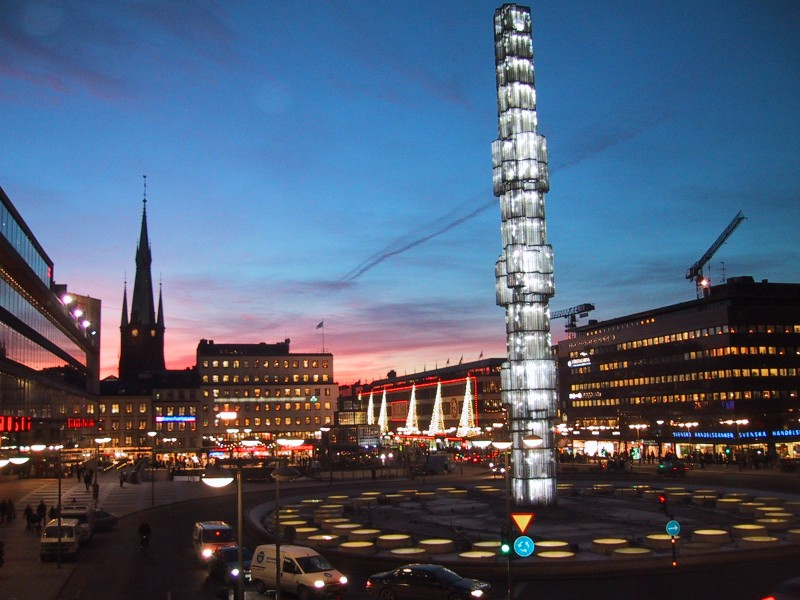 Stockholm City Center with Ahlens Shopping Mall (triangle lights and red trim). Photo Credit: dorothytours.se