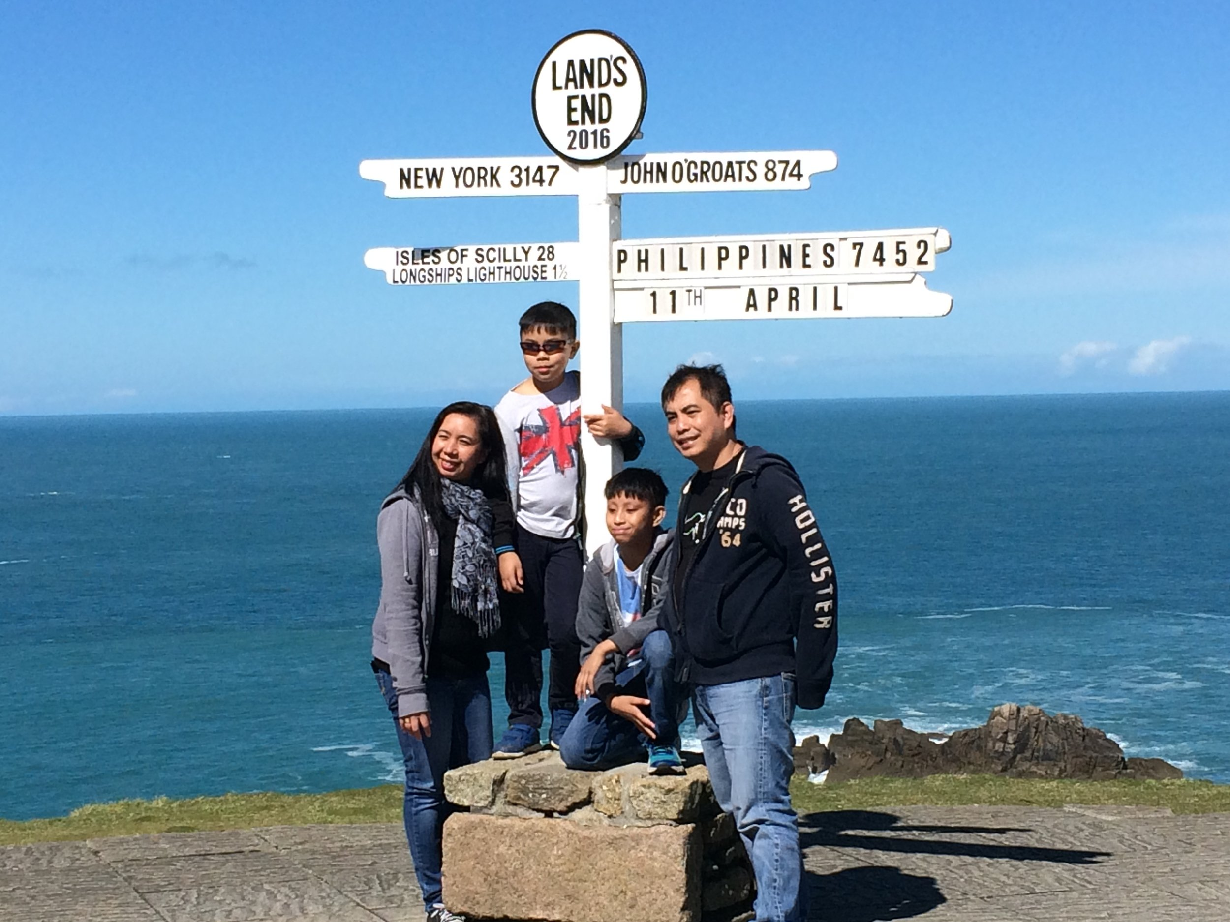 The most famous landmark at Land's End is the signpost, but since they charge 9 pounds just to pose (plus the cost of the photo), I took a shot of this Filipino family instead.