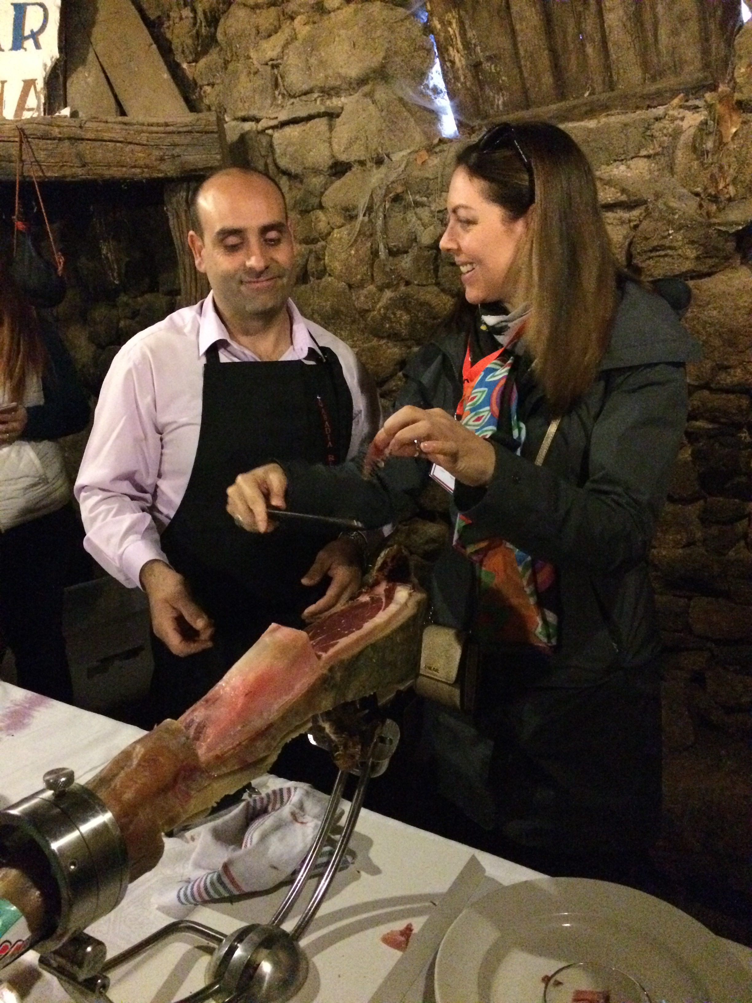 Learning to slice Iberico ham from the master. You can tell by his face how well I did!
