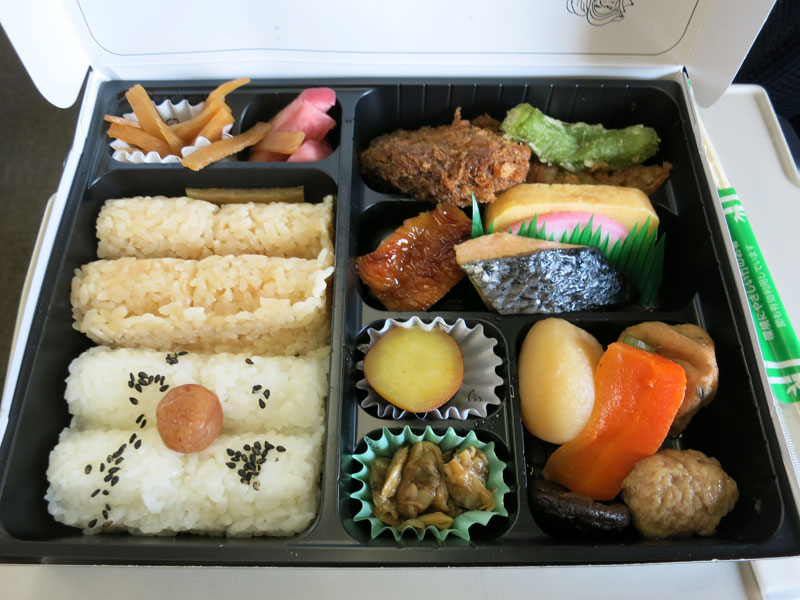 Besides rice and the piece of fish, I challenge you to name the other components of this Bento
