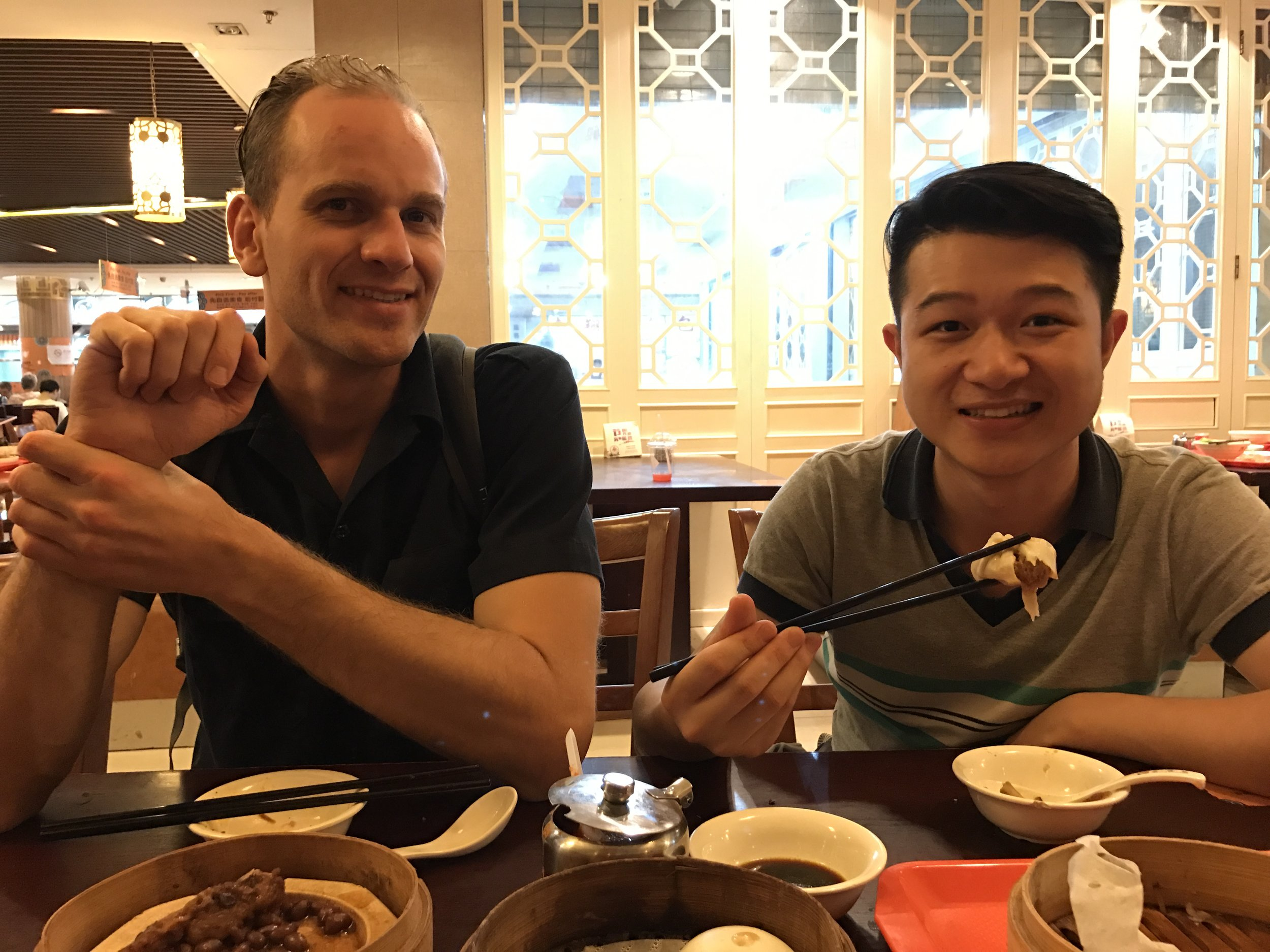 Chicken feet and squid skewers at Yuyuan market