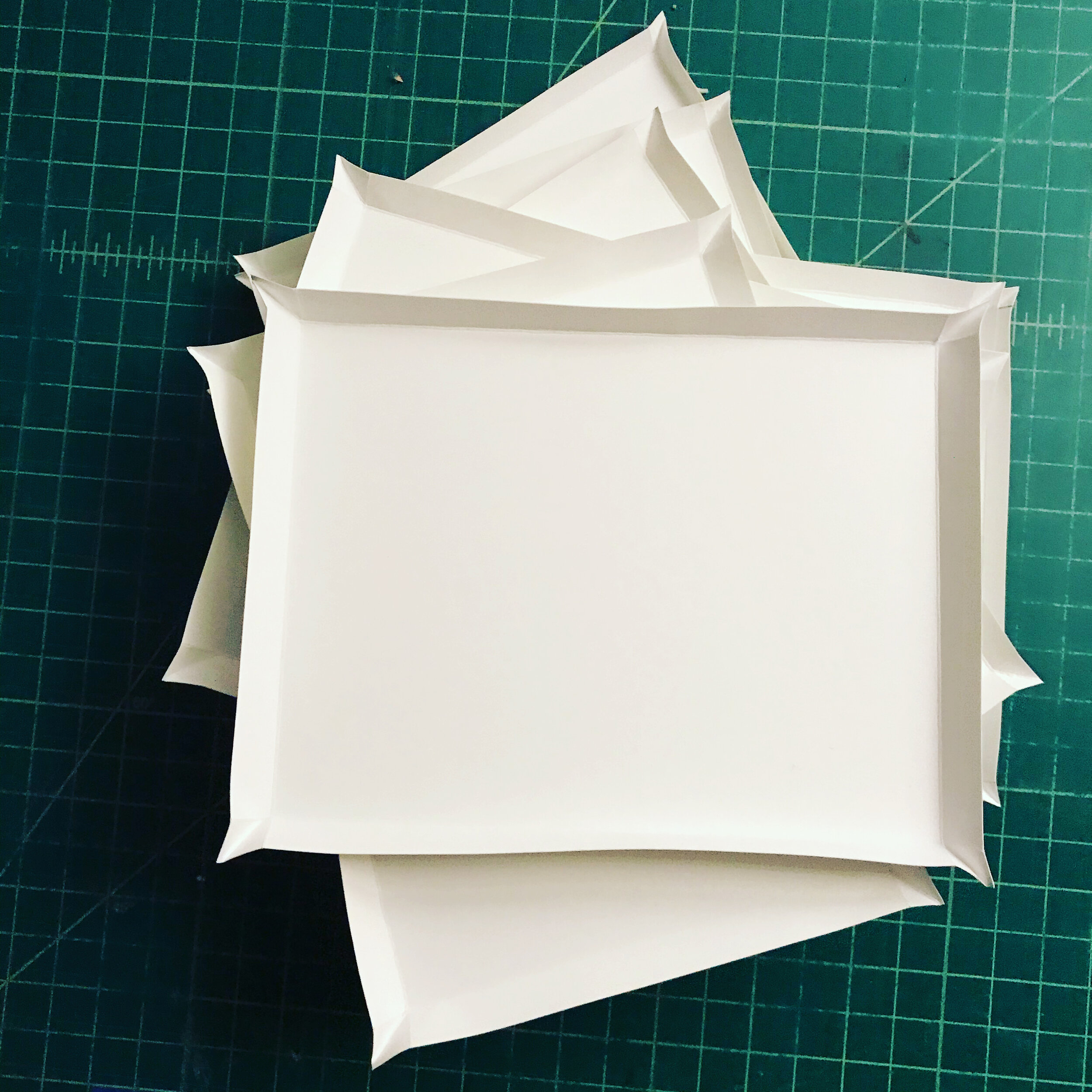 Scored and folded paper