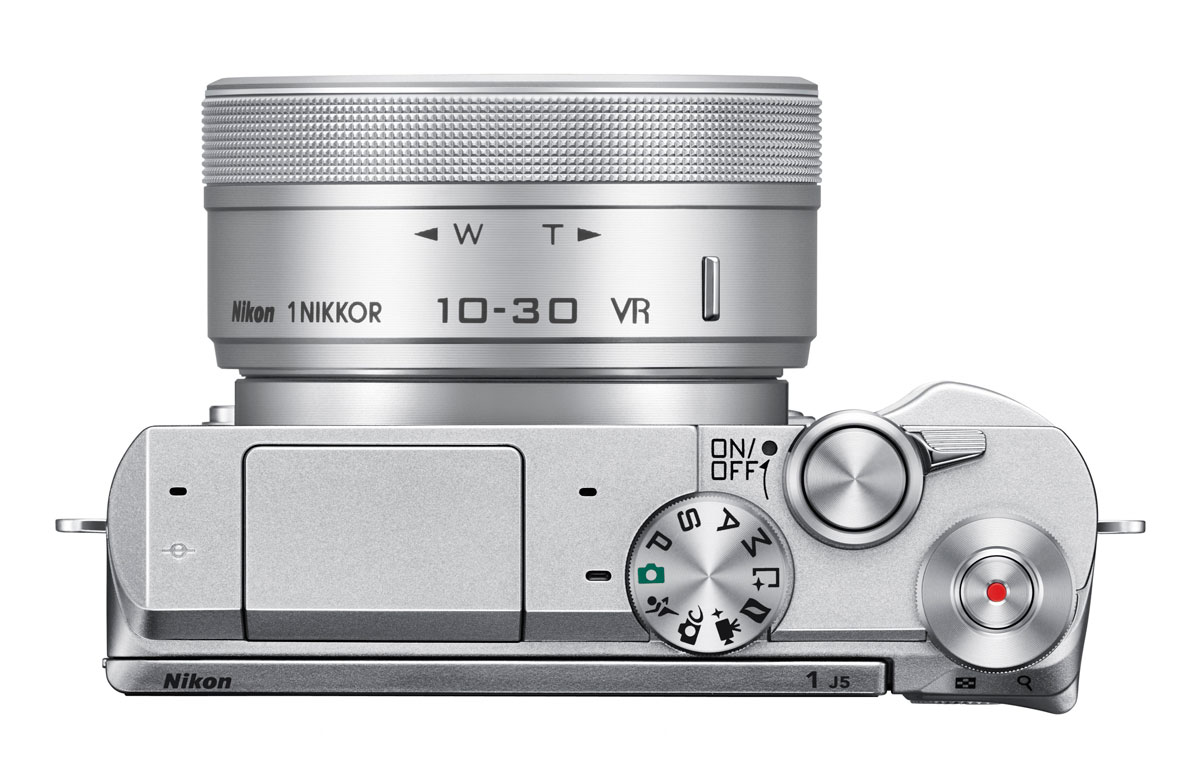 The Nikon 1 J5 top deck has a very clean layout
