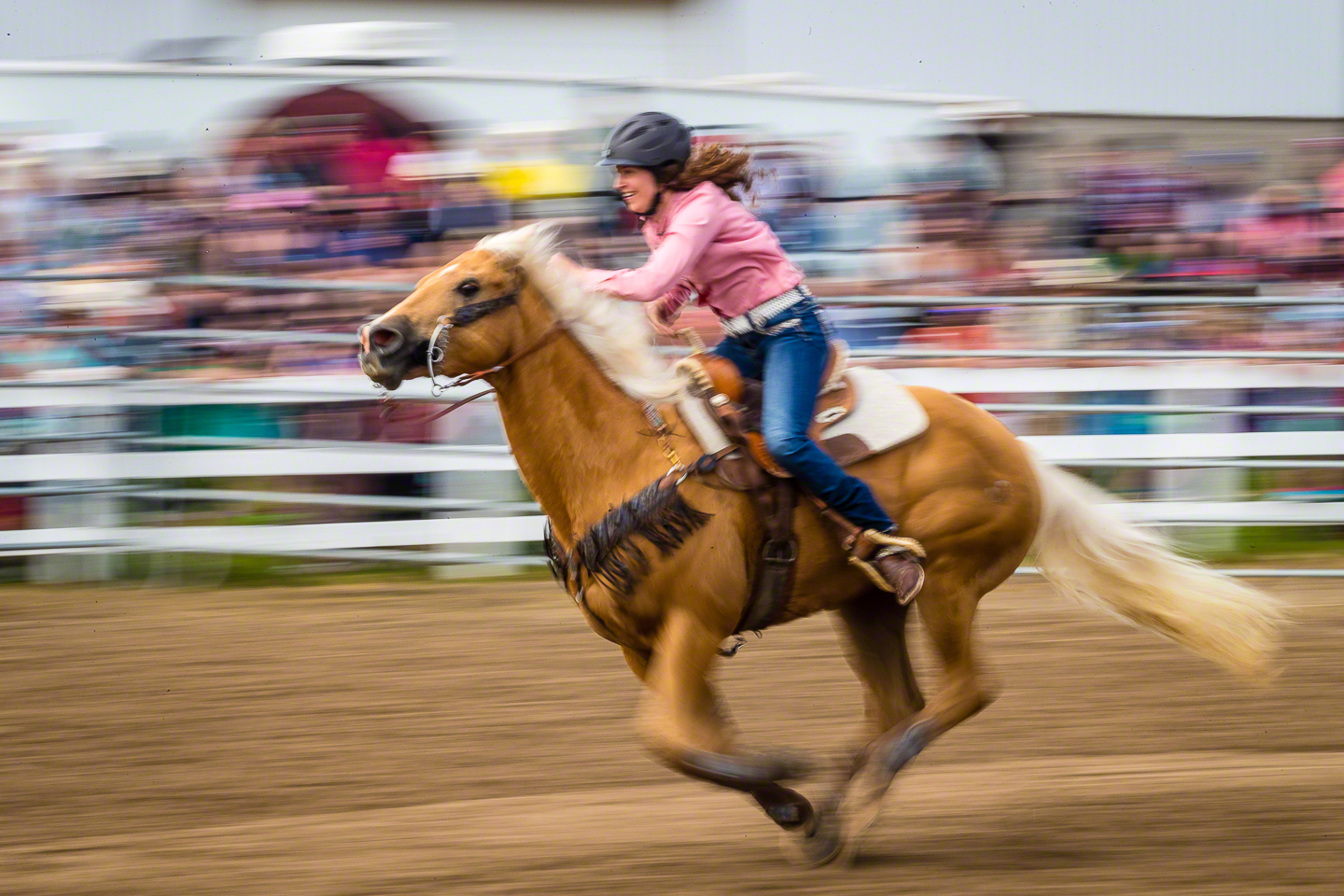 Camera in continuous auto focus, with me tracking the rider and holding down the AF-ON button with a slow shutter speed and a pan to capture the motion of the horse and rider. Without back button focus, this shot would not have happened as successfully.