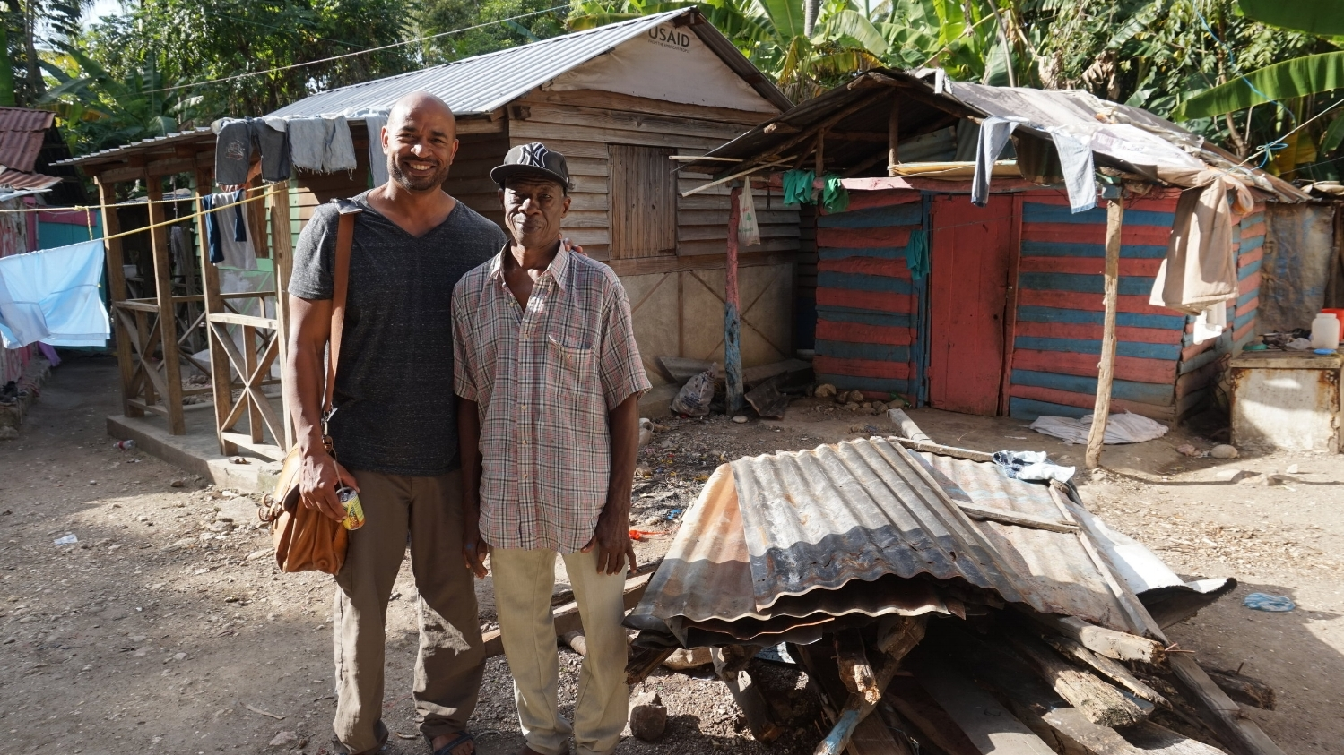 Malcolm and Ofranes standing in front of his torn down vodou temple where the Jacmel group now holds their weekly Bible studies