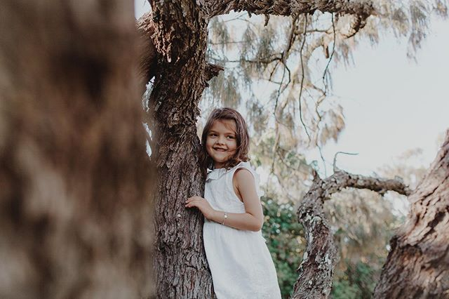 Darling little angel, climbing trees without a care in the world! #familyphotos