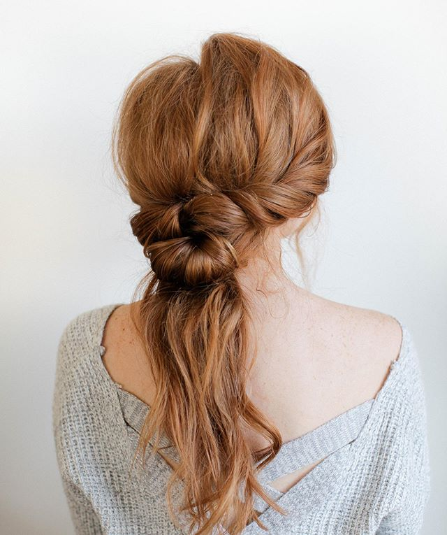 A tiny tutorial for your Friday!  Start with texture hair- we sprayed @oribe texture spray and loosely curled with teasing in the crown.  1. Twist each side to form a half up half down  2. Split the bottom hair in half and tie in knot  3. Pin it under itself as you fan out the knot a bit  4. Tease the tail to give it some mass and pull out some baby hair in the front for a more relaxed tousled look. ➰  Let us know if you try it and tag us! -mojo