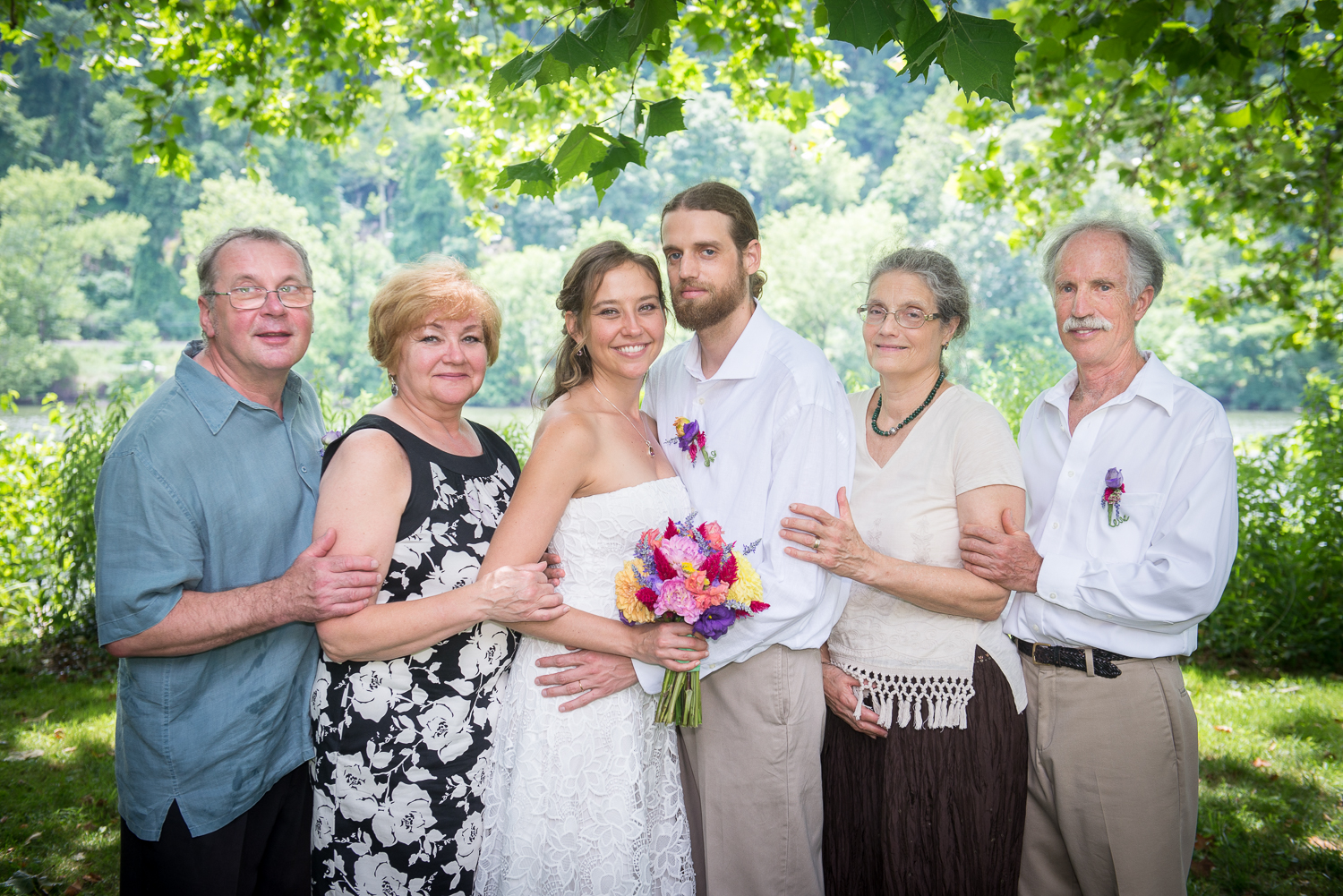 Two families joined in matrimony: the bride and groom with their parents.