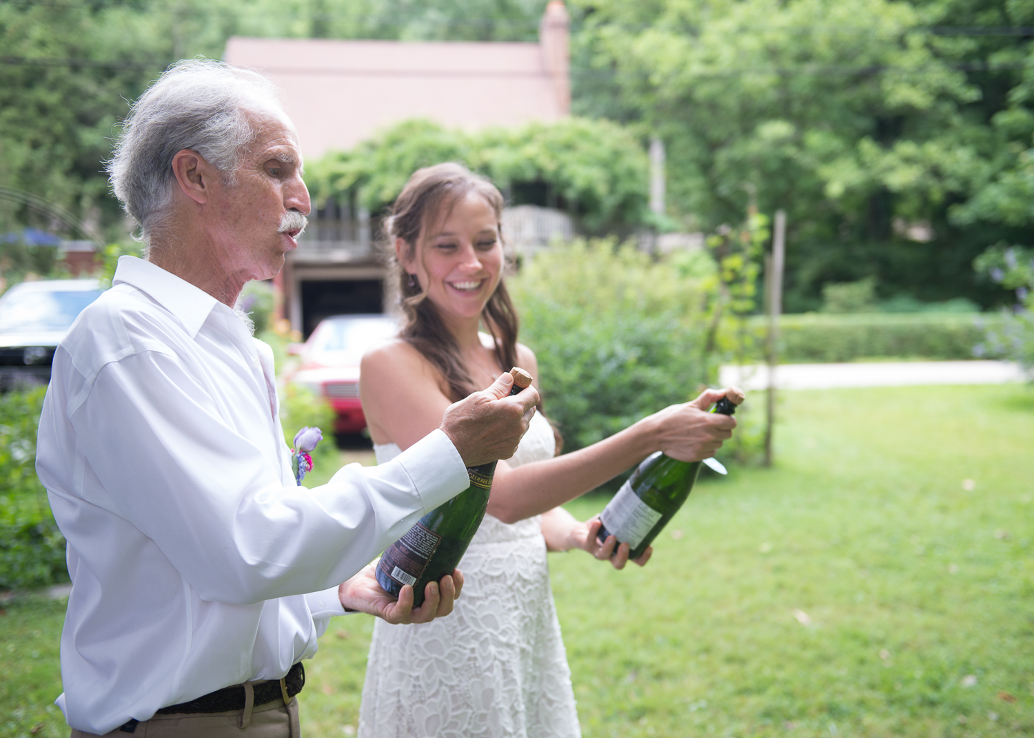 Aaron's dad, Joe, teaches Ada how to open a bottle of champagne.