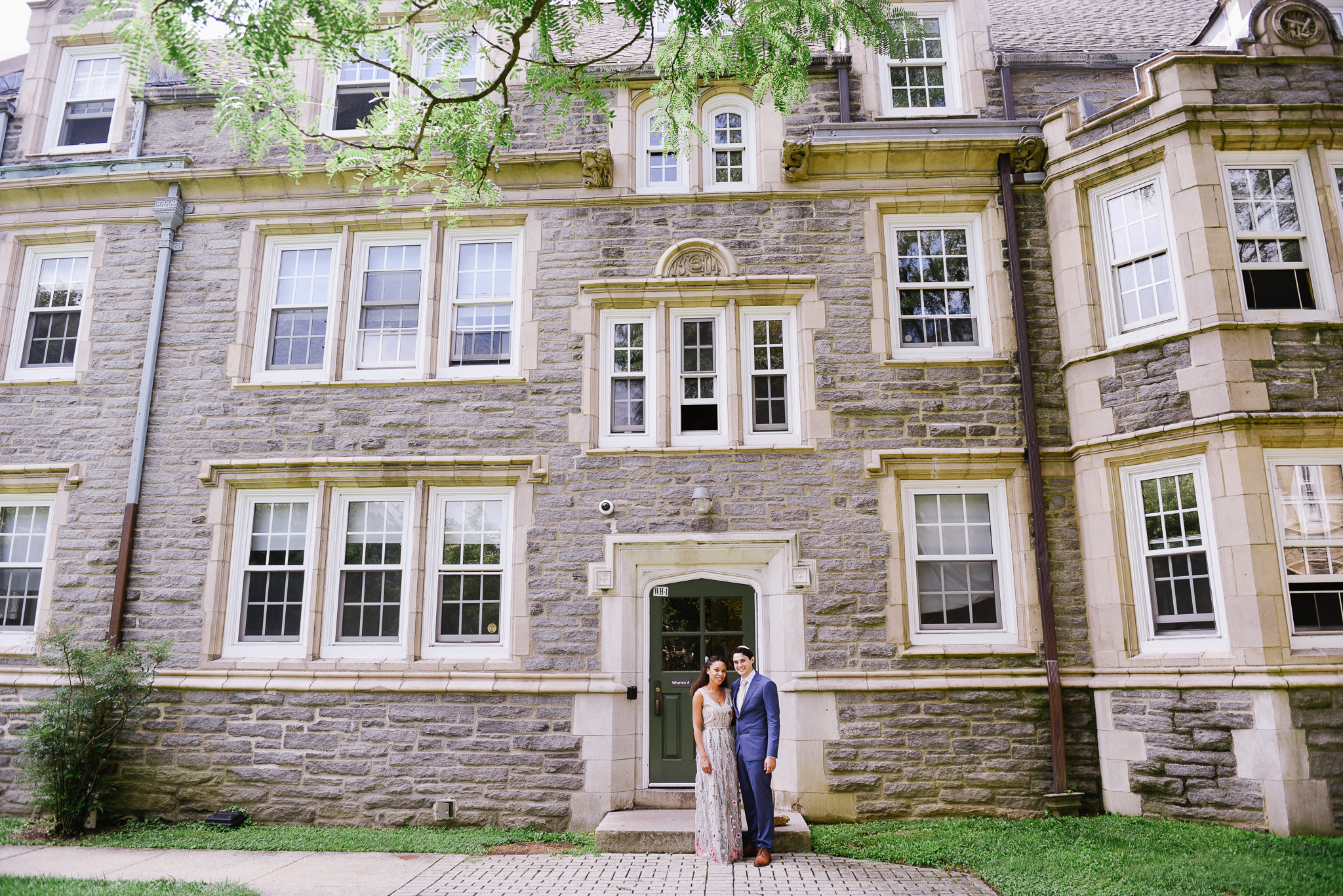 The couple poses by the dorm building where Alicia lived when they first met.