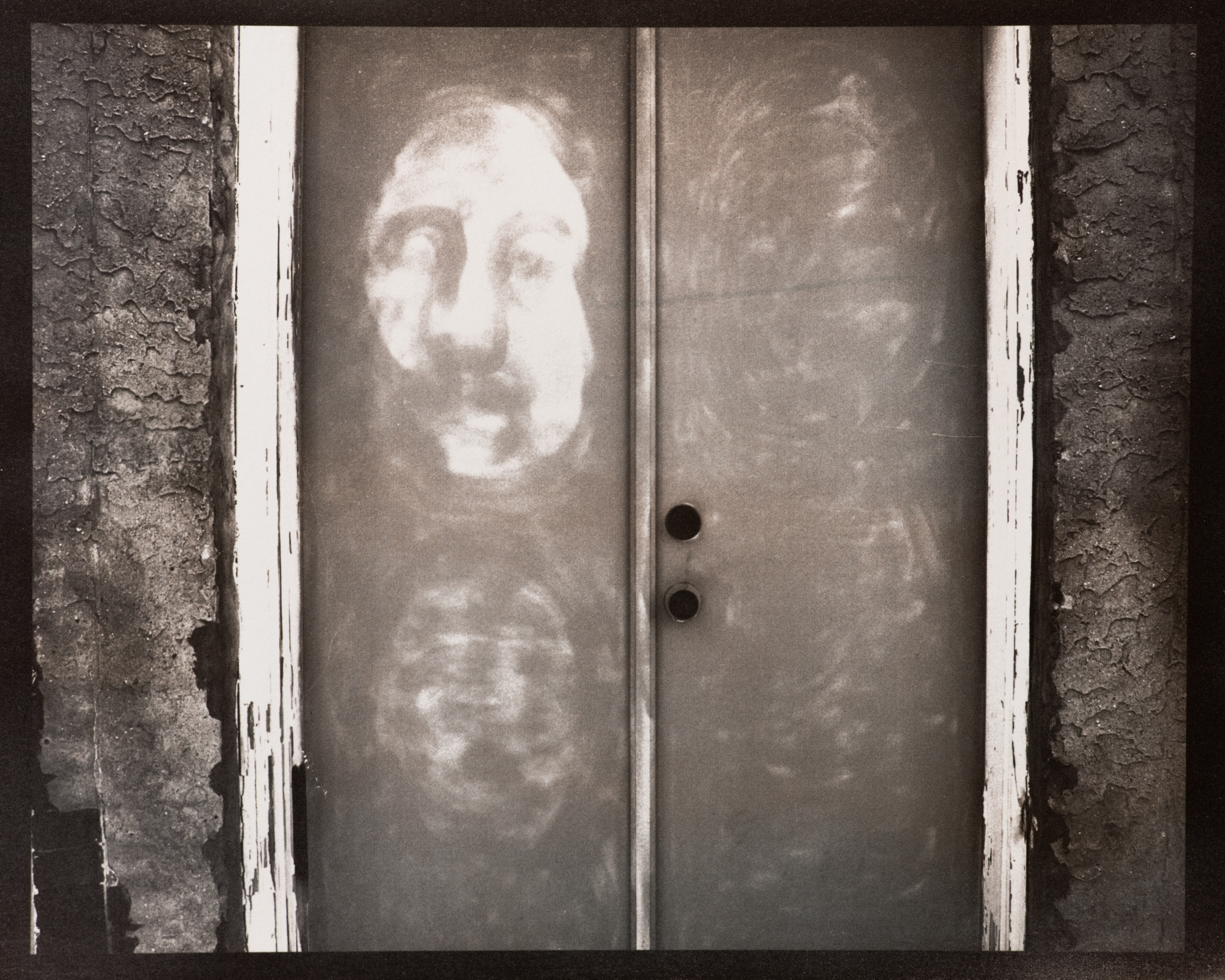 Faces on a Doorway