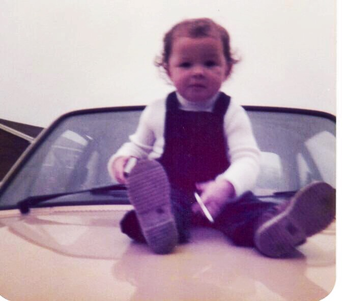 This is me, in 1980, sitting on the bonnet of a (probably moving)car and smoking what appears to be, yes, a fag. Like I say, parents were more relaxed (see also: negligent) in the olden days.