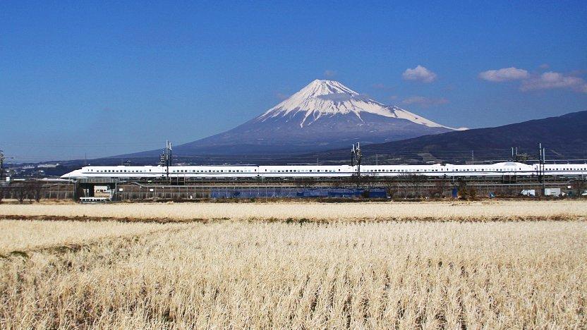 the shinkansen passing through a splendid view of mount fuji.