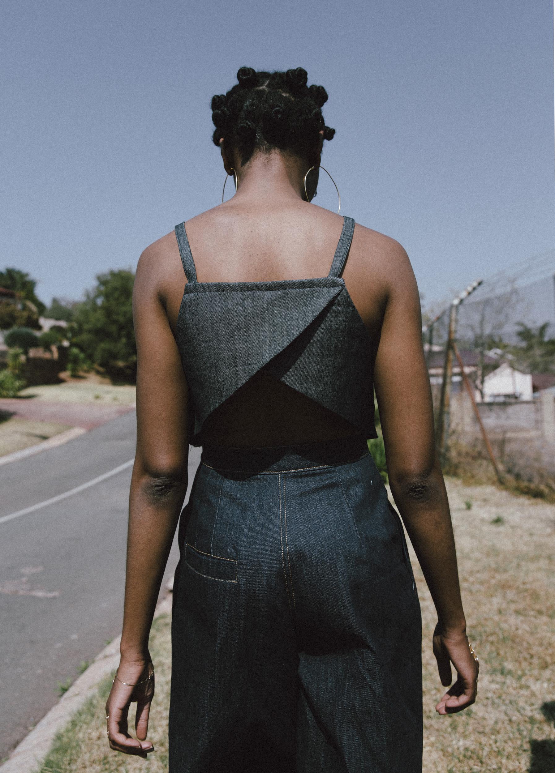 Lindiwe wears earrings, Lulubelle; crop top, Akedo; culottes, Oath Studio