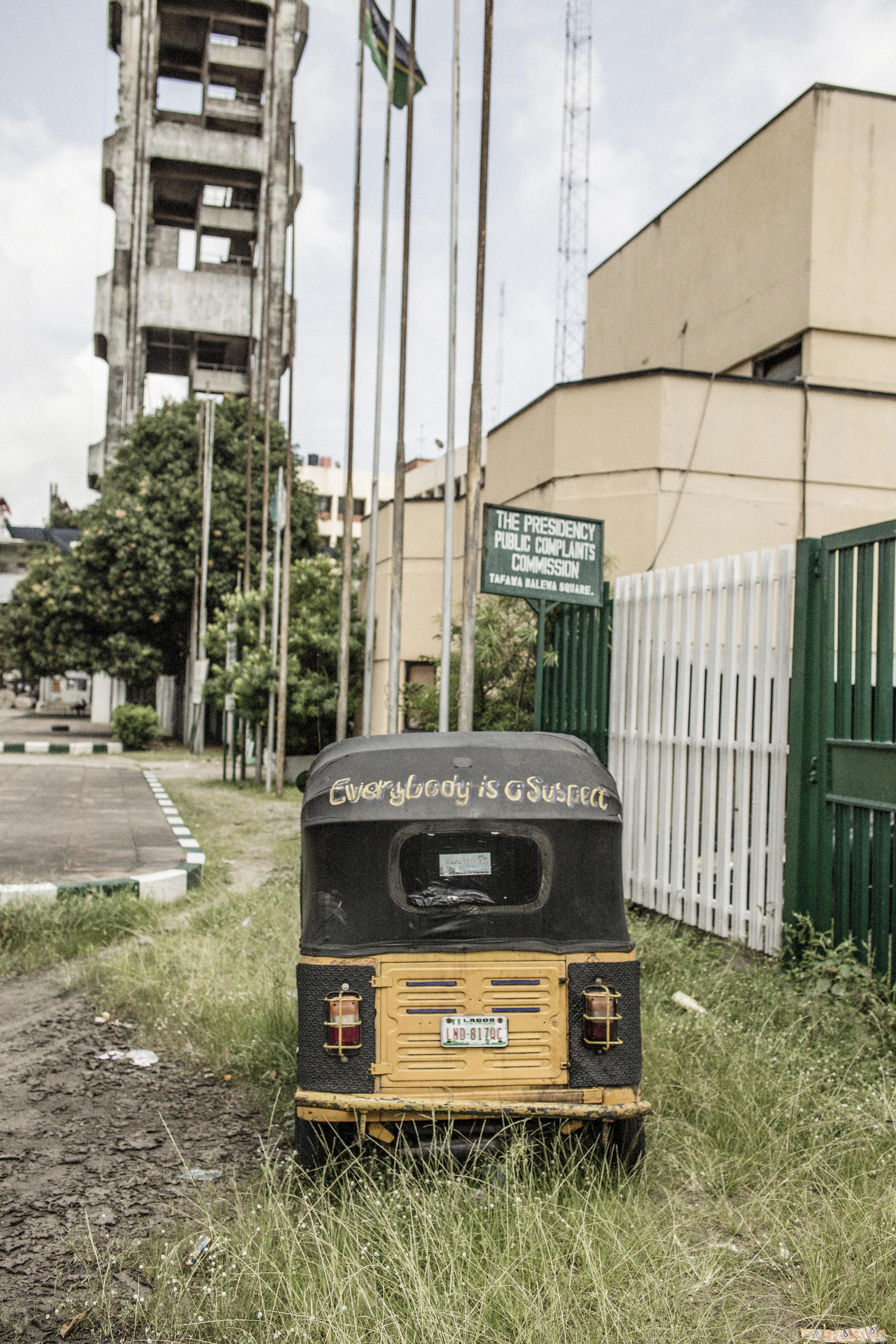 A rickshaw parked next to   Tafawa Balewa Square