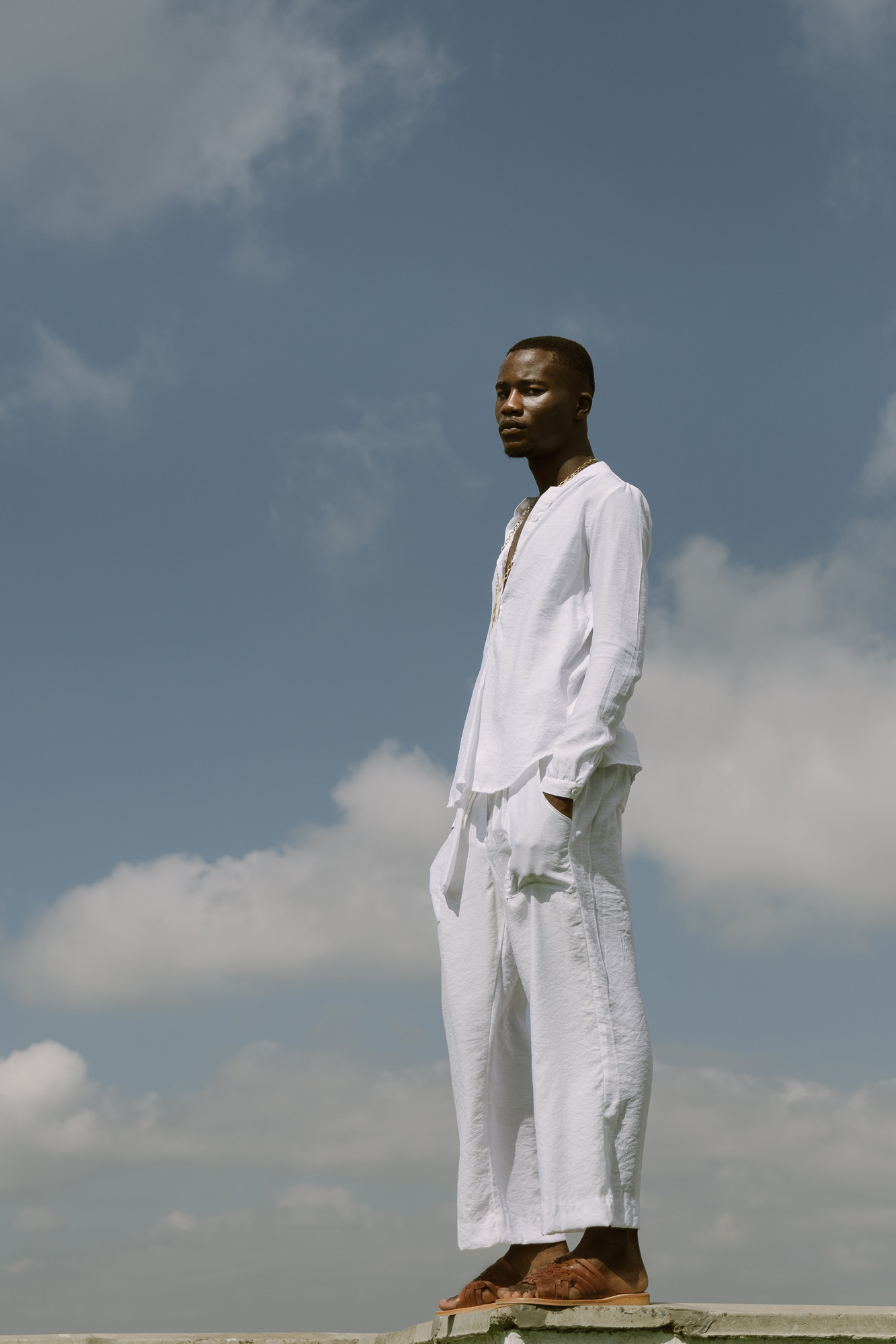 Randy wears Haute Baso shirt and trousers, Embody necklace, own sandals
