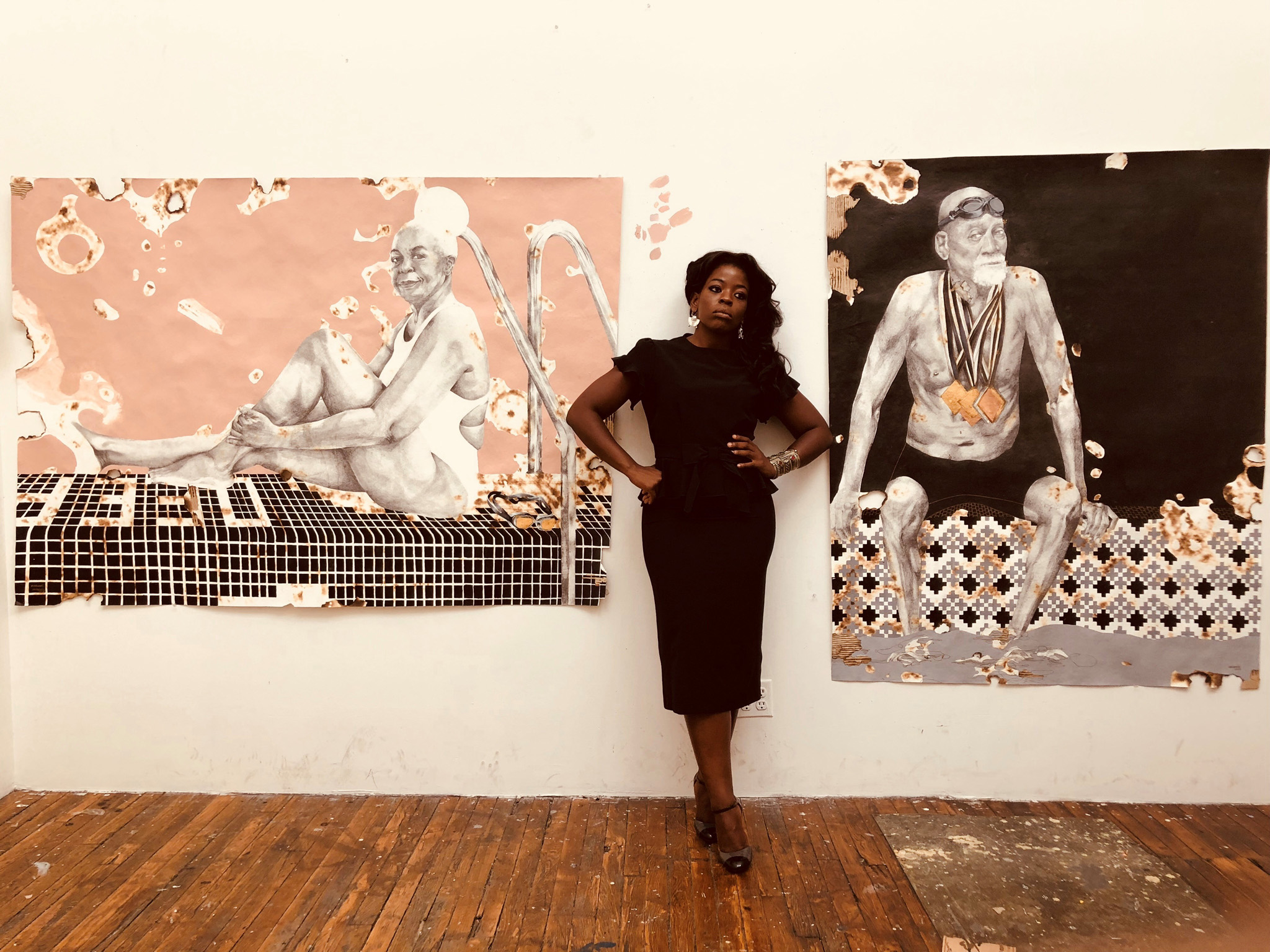 Modupeola Fadugba in the studio in front of works from Dreams from the Deep End. Image courtesy of the artist and Gallery 1957