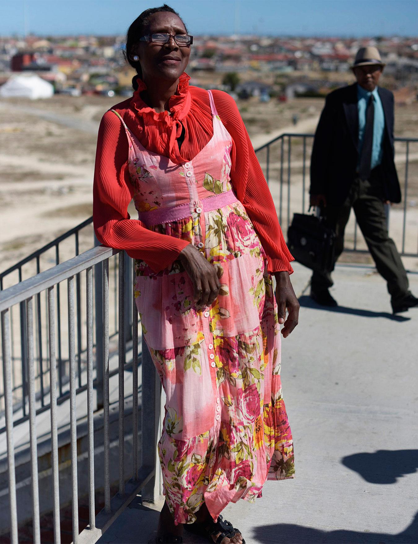 Fatima wears earrings and bracelet, Oriental Plaza; roll-neck, Jil Sander; suit, Akedo