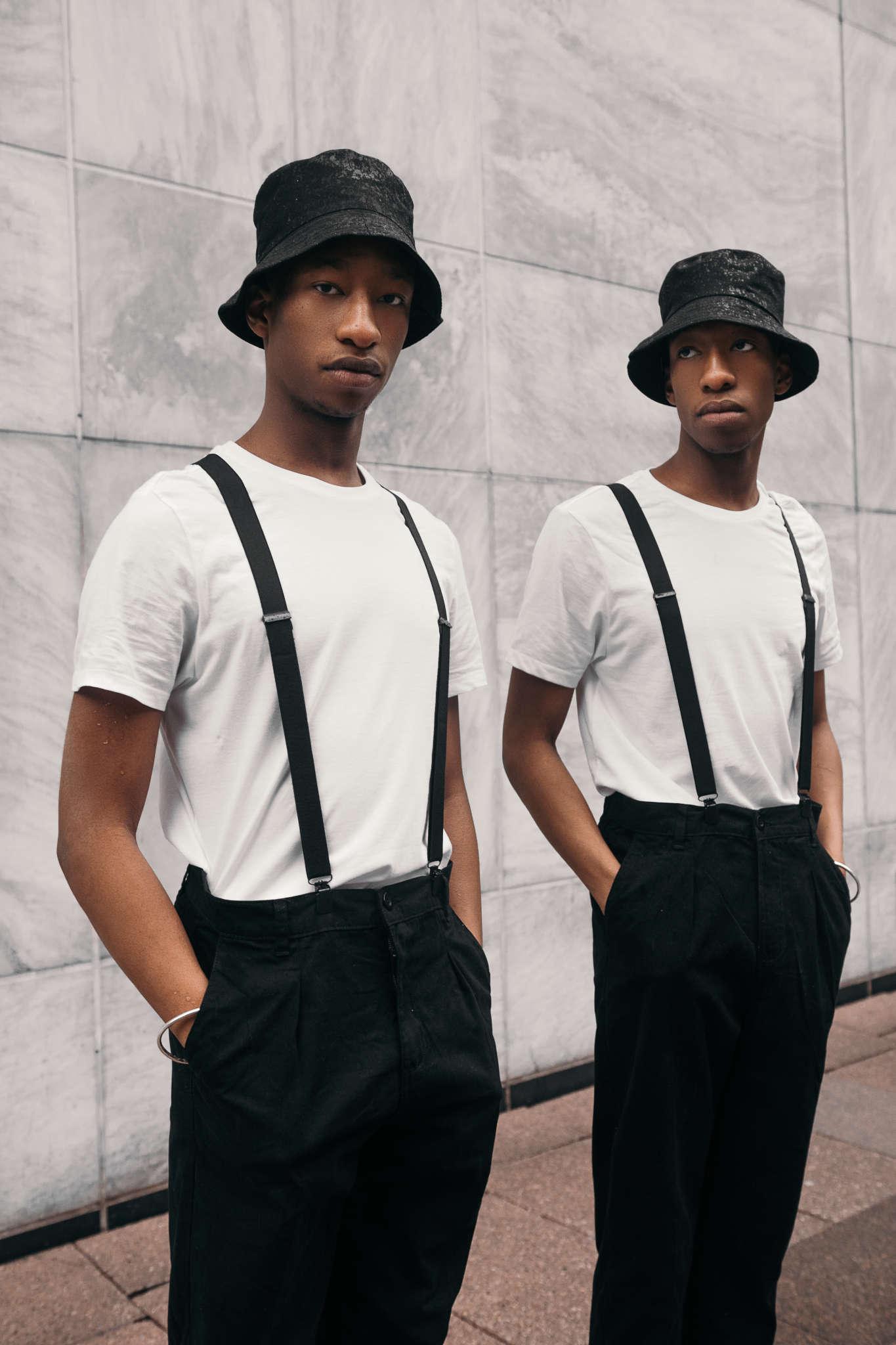 Dijon and Devontay wear Atika London hats, Sunspel t-shirts, Hugo Boss trouses, Charles Tyrwhitt braces, Eleventy socks, Base London shoes, model's own jewellery