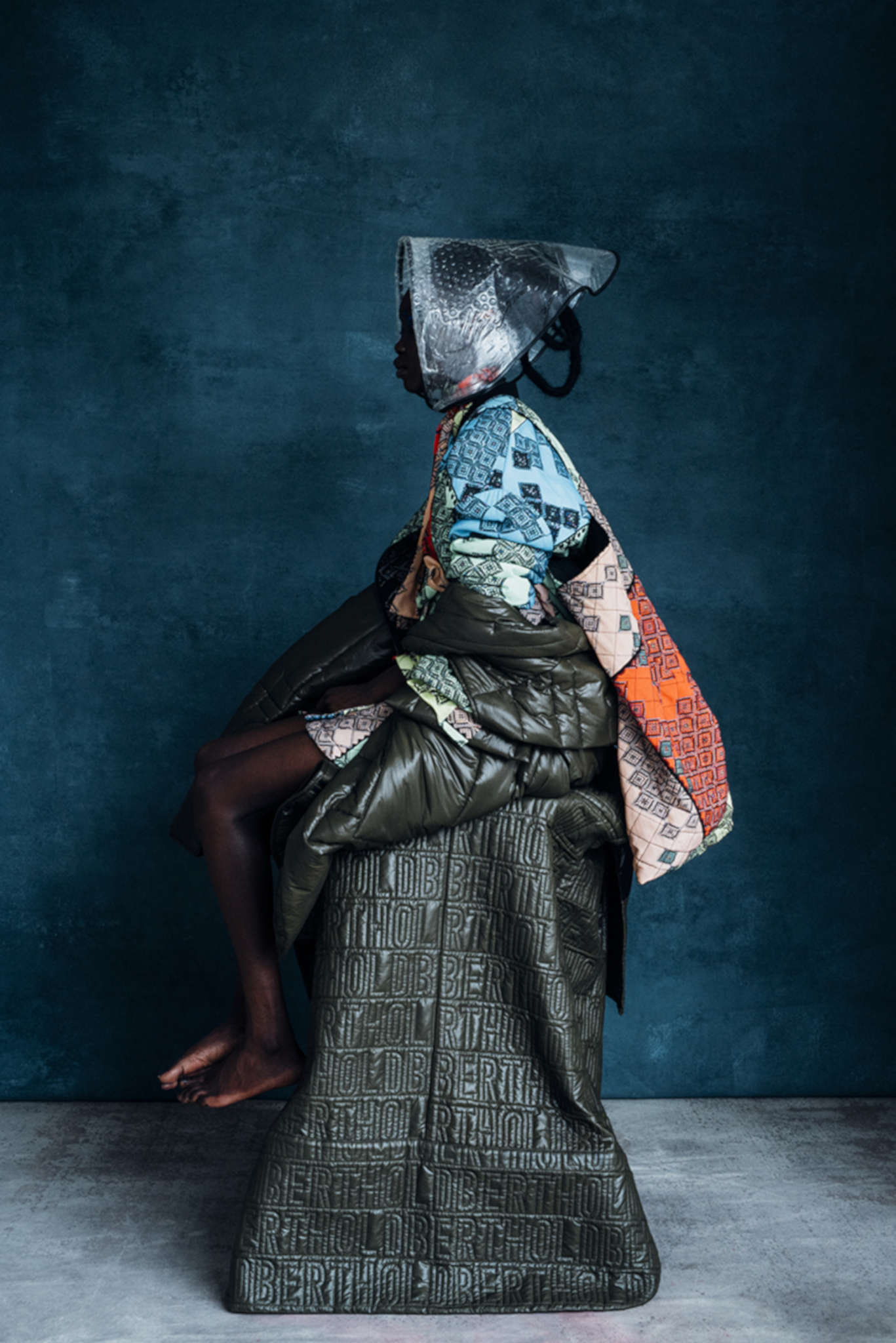 Preen Line jacket, blouse, skirt and bag, Jo Miller headpiece, Berthold puffa coats