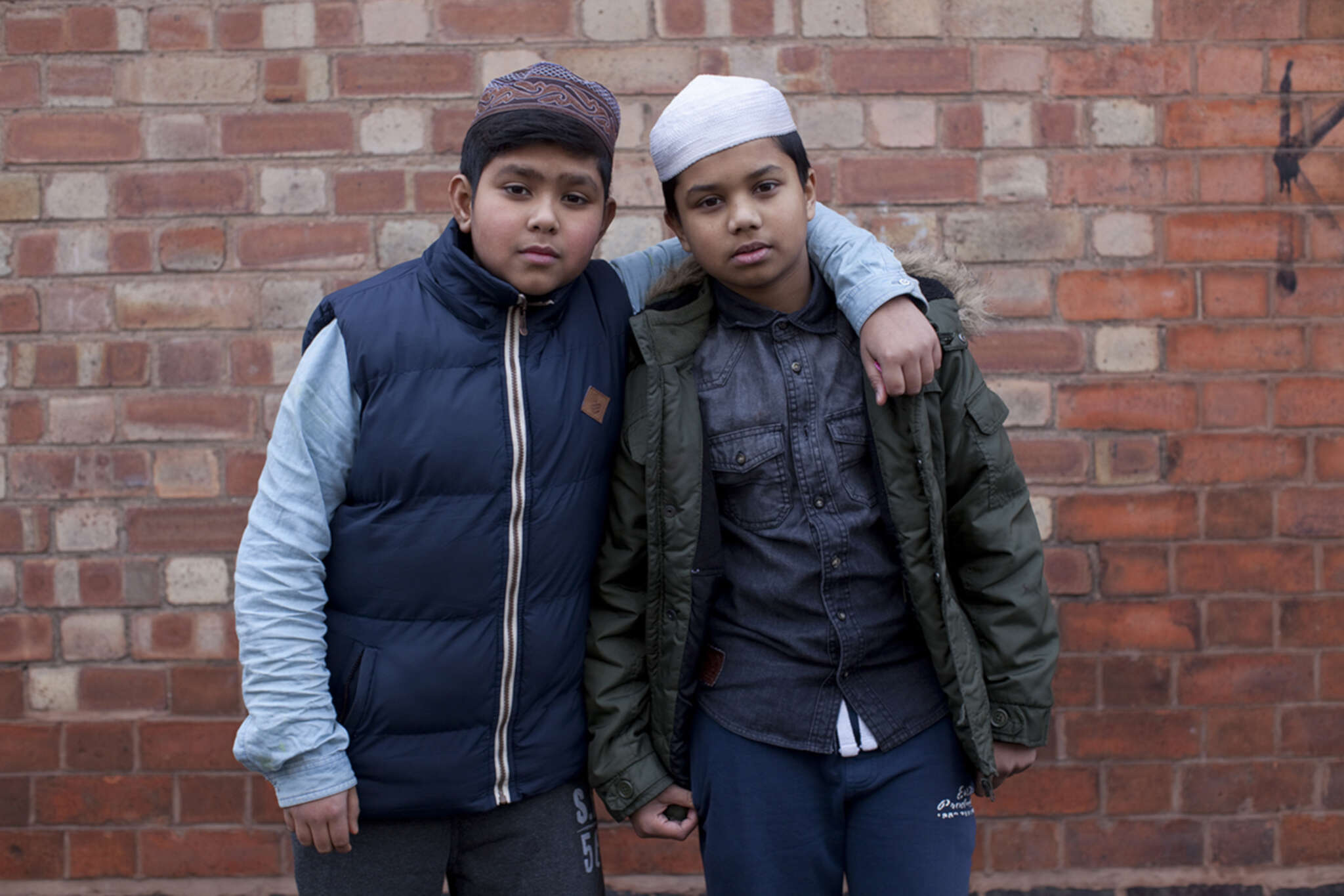 Friends and skull caps - The Quiet Town of Tipton ┬®, 2013 - 2015 © Mahtab Hussain