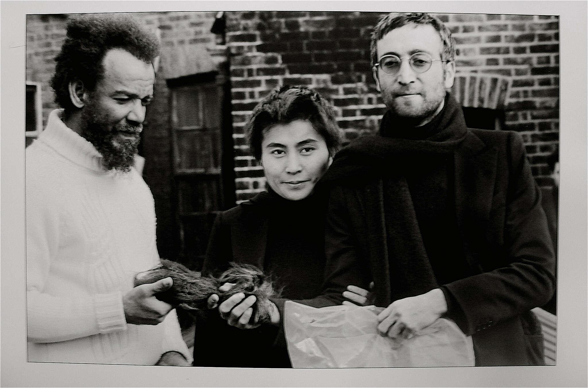 Horace Ové, 'John Lennon giving Michael X his hair to auction, 1969'artist