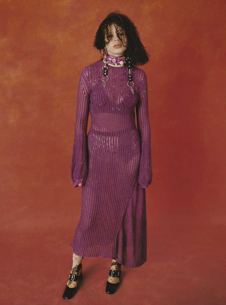 SOPHIA wears CHLOÉ dress, WOLFORD tights, DORATEYMUR shoes, GABERON earrings.
