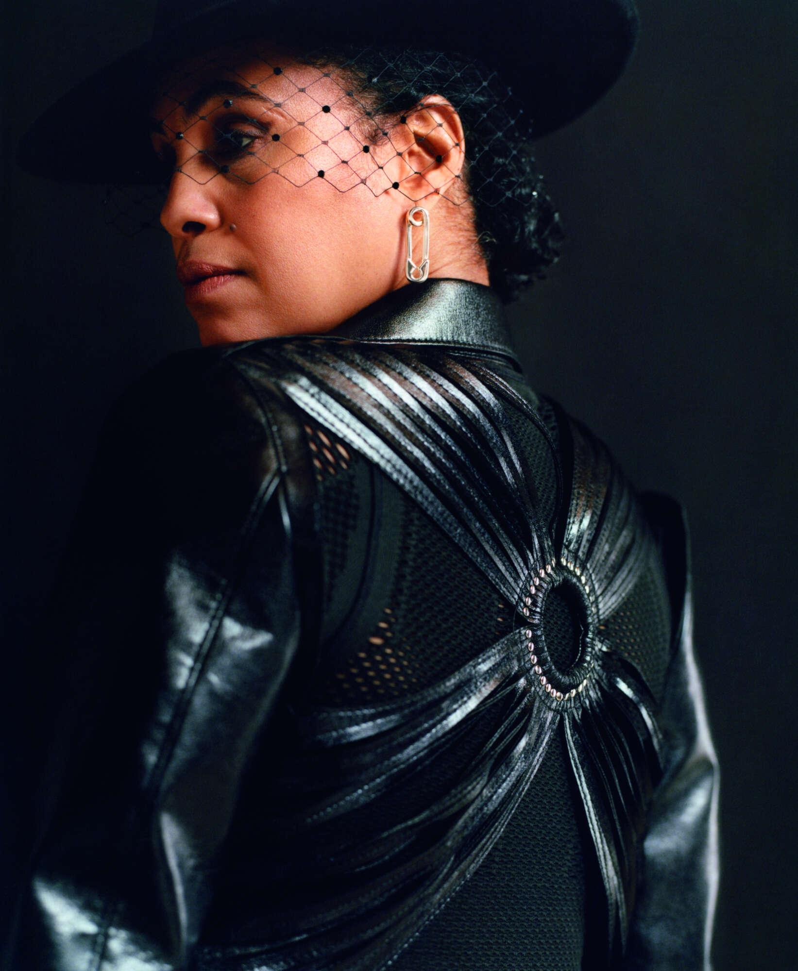 NENEH wears Y3 top, NOIR KEI NINOMIYA jacket from MACHINE-A, PHILIP TREACY hat.