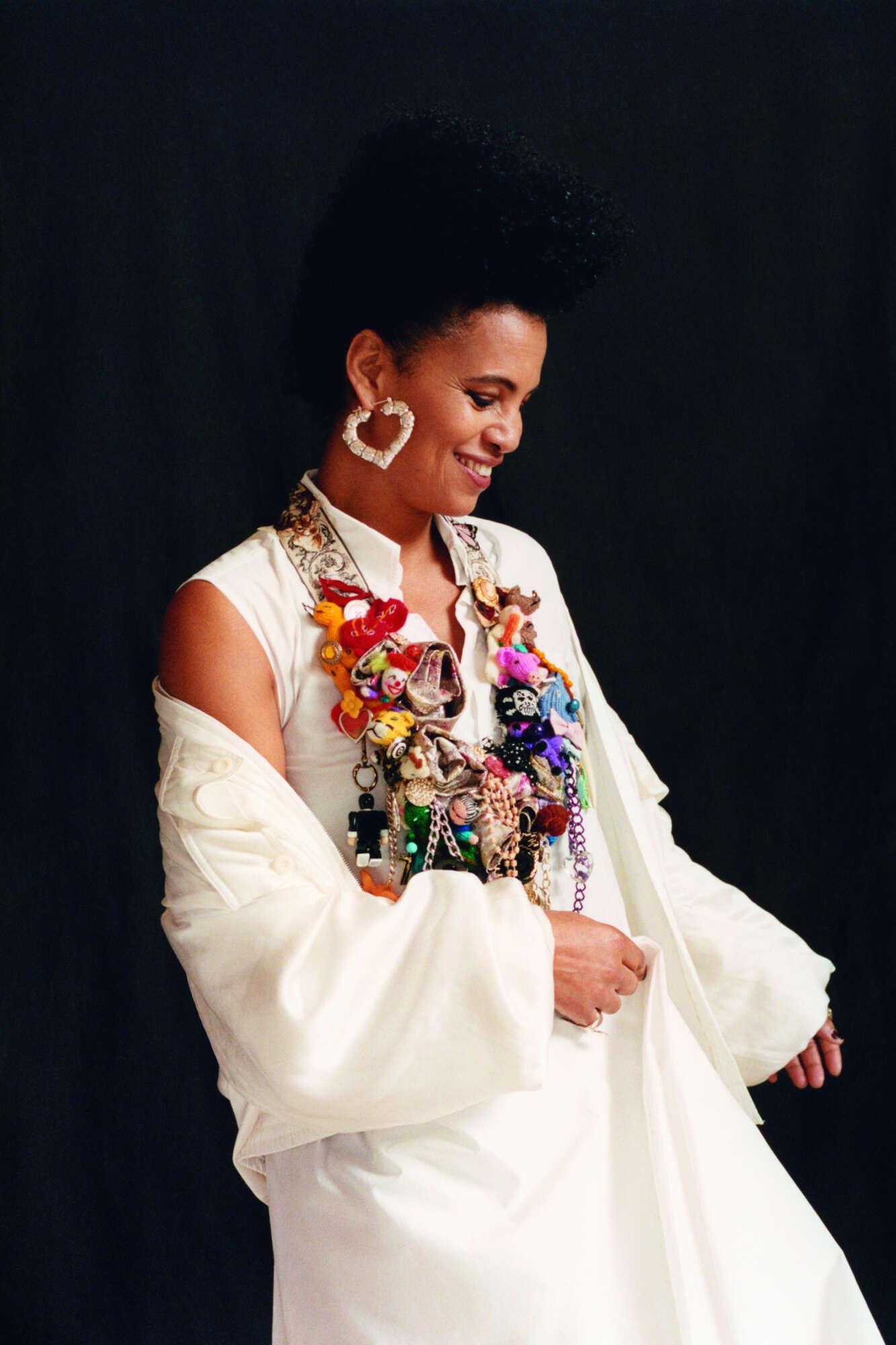 NENEH wears MM6 dress from MACHINE-A, KATHARINE HAMNETT jacket, JUDY BLAME necklace.