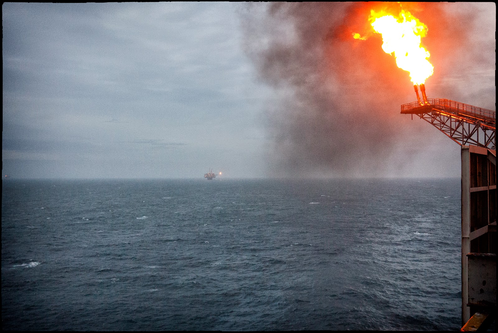 business gasoline oil fuel petrol action blue colour image consrtuction fields fire flares industrial building ocean oil rigs outdoor seascape