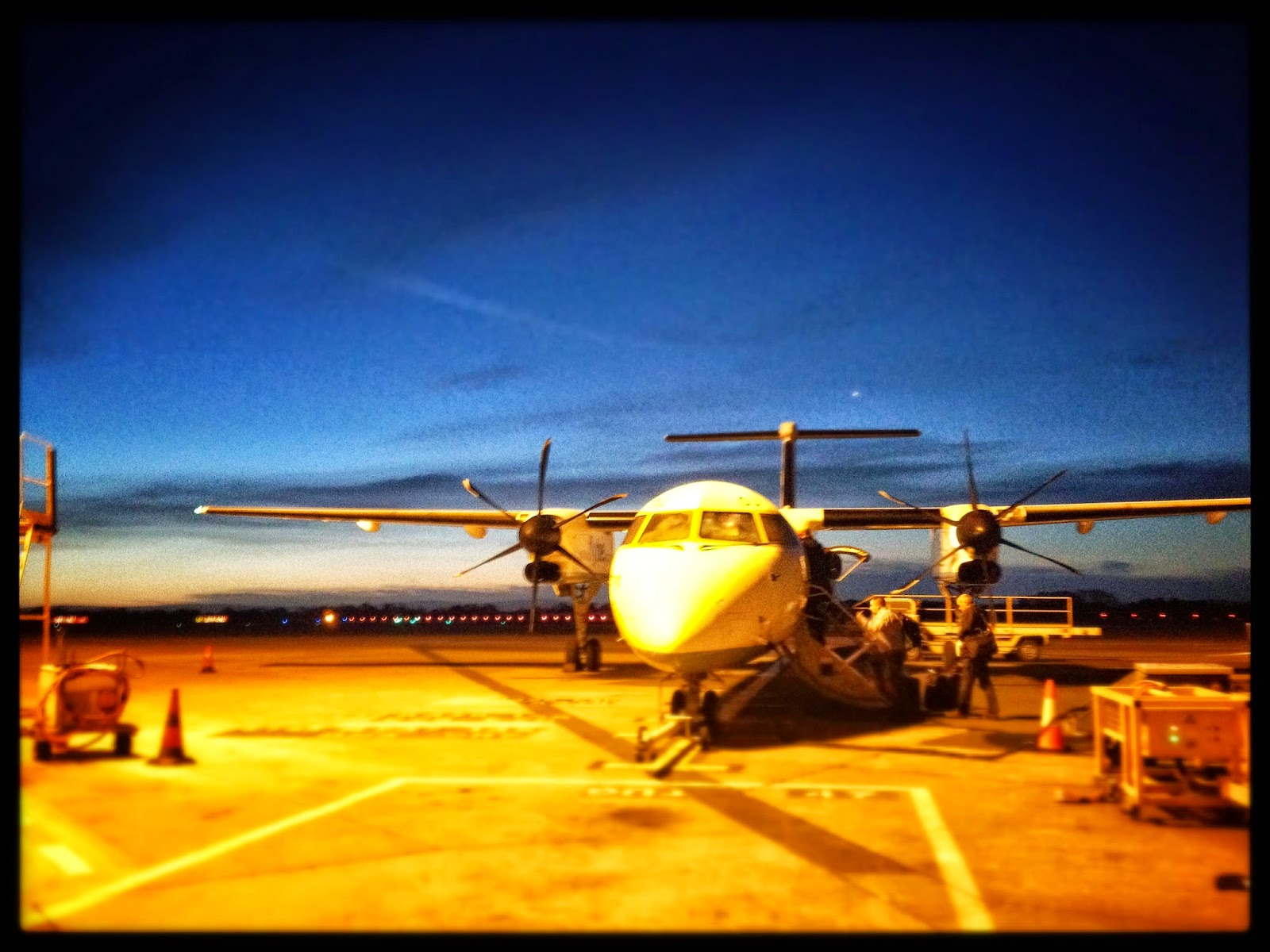 Aberdeen airport flight shetland work business plane airoplane cold morning commute luggage workers construction travel air miles eastern airways flybe, british airways, run way, stand